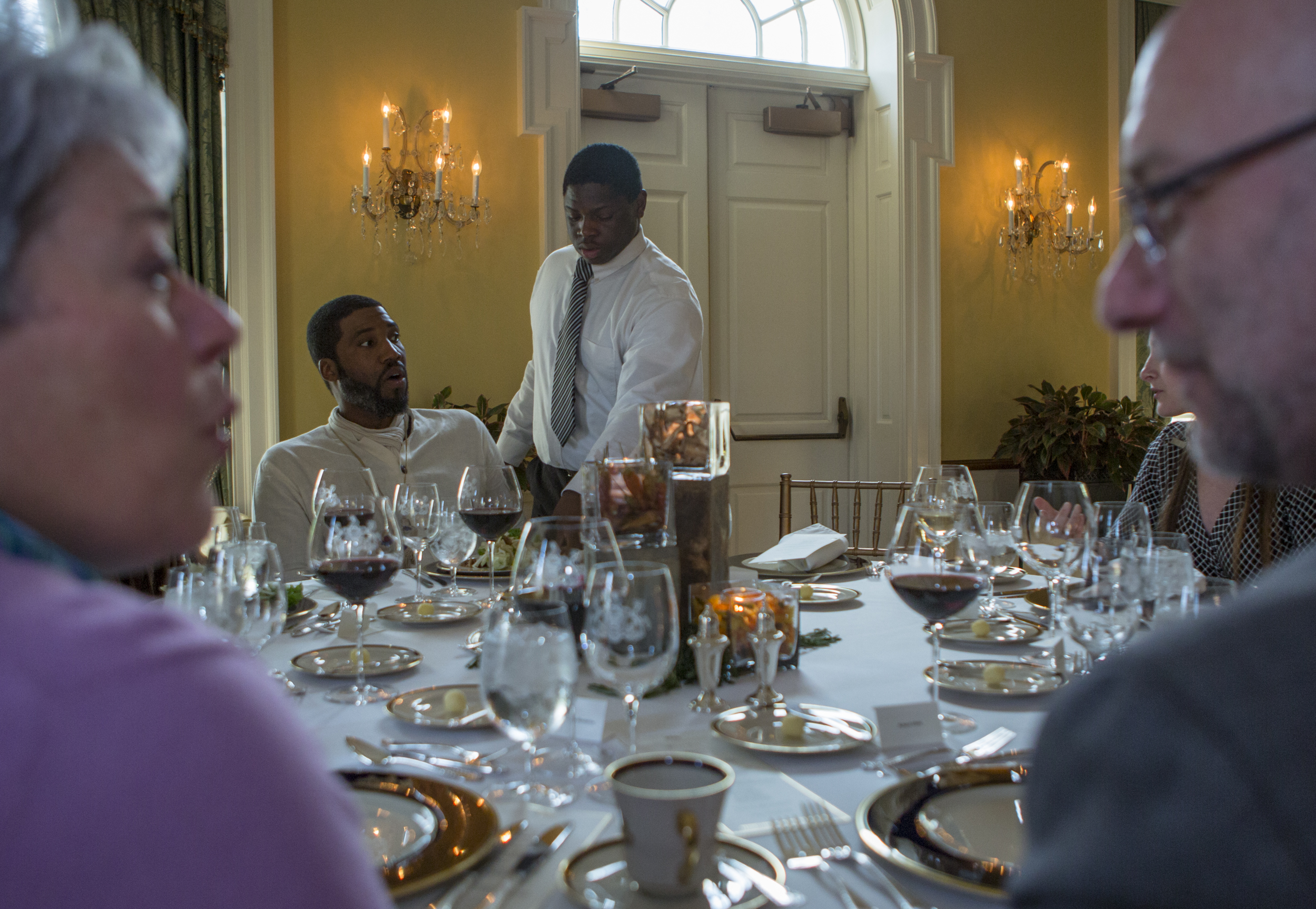 CPI culinary student Eli Lipscomb serves a salad to Penn State graduate student Eric Farmer as part of the dinner hosed by CPI students and staff at the Governor's Residence in Harrisburg on Monday, April 11, 2016.