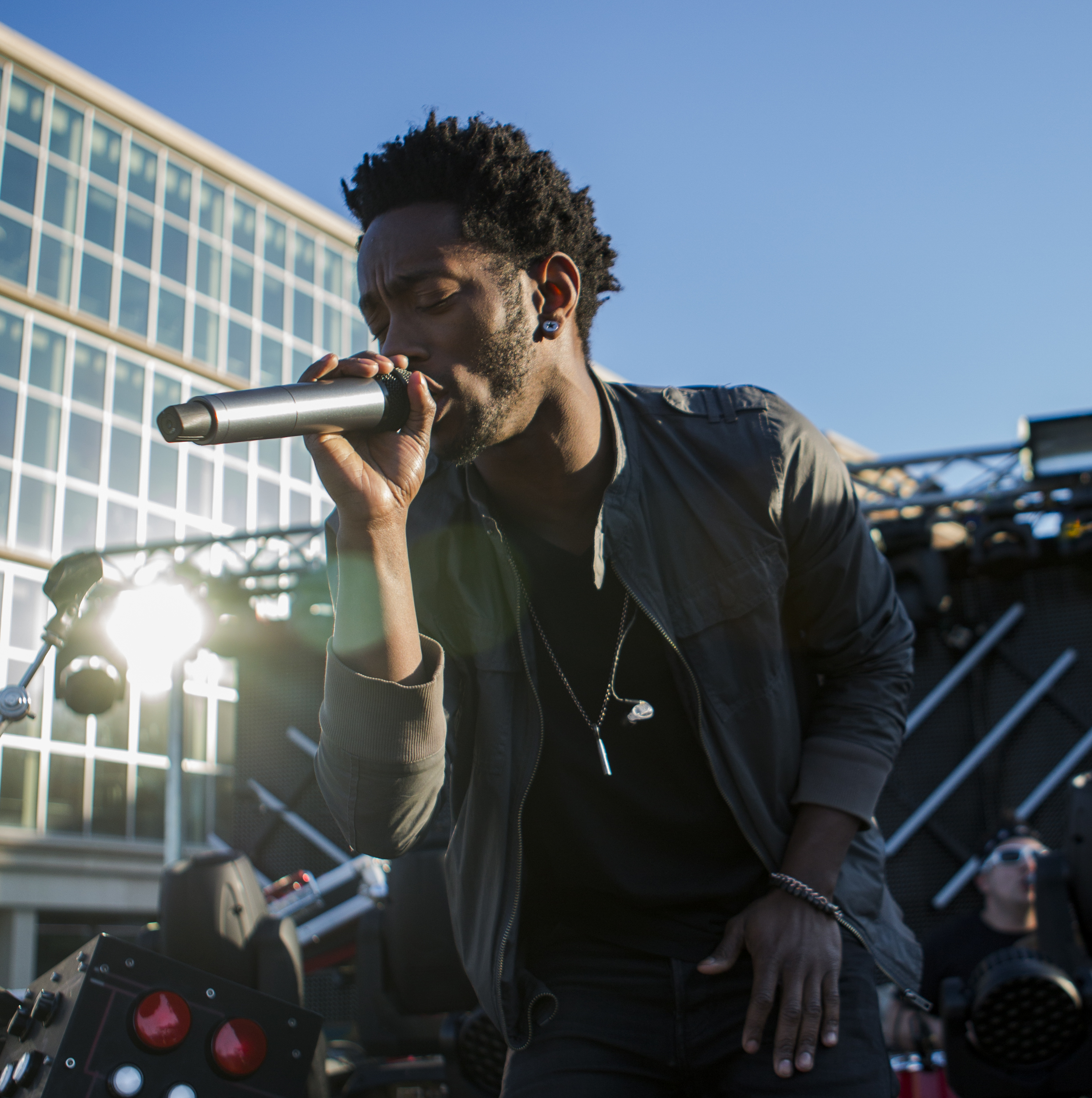 Go Go Gadjet vocalist Rayvon Reed performs with the band on the HUB lawn as part of PSiheartU week on Thursday, April 14, 2016.