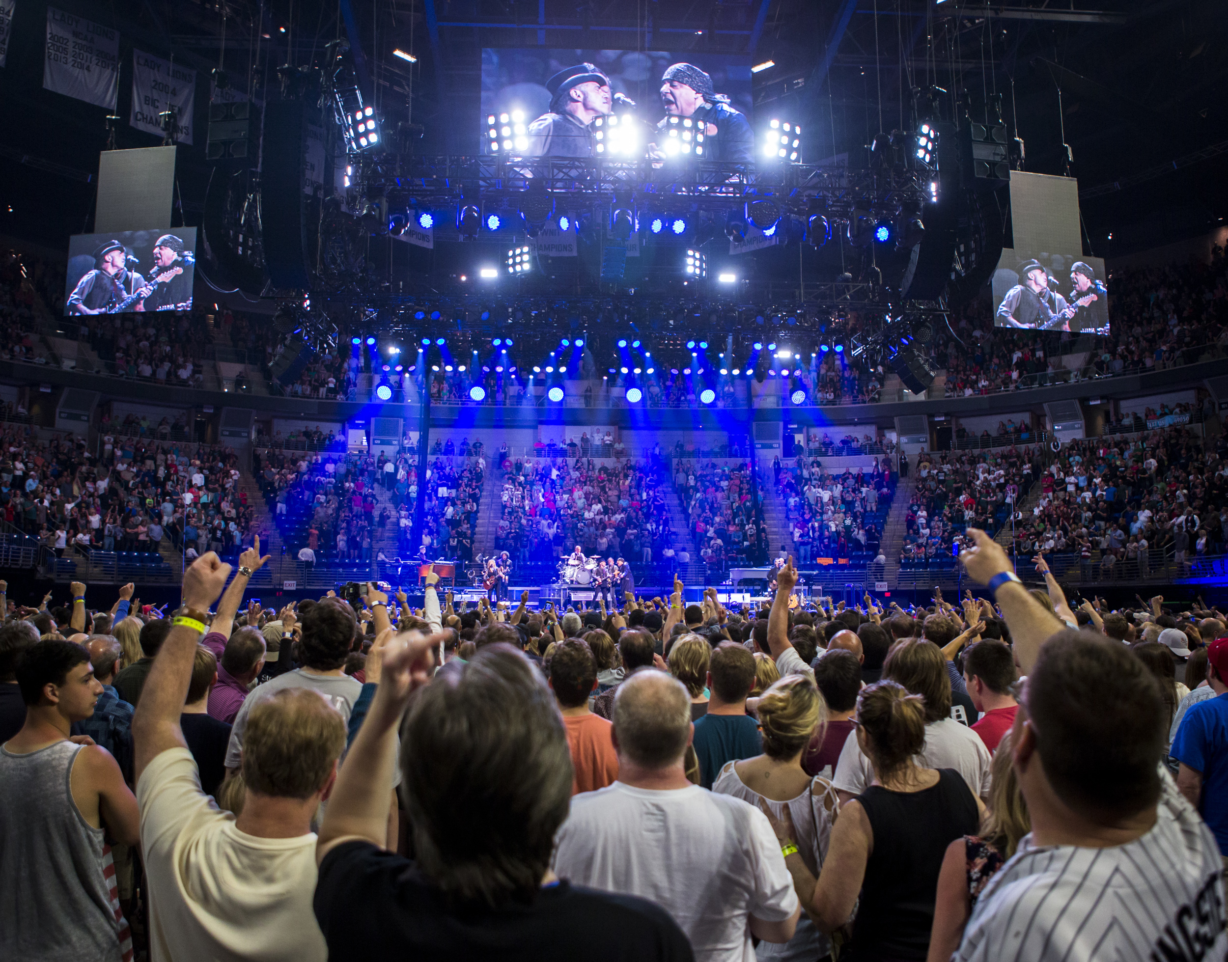 Fans sing along with Bruce Springsteen and the E Street Band during their performance at the Bryce Jordan Center on Monday, April 18,2016.
