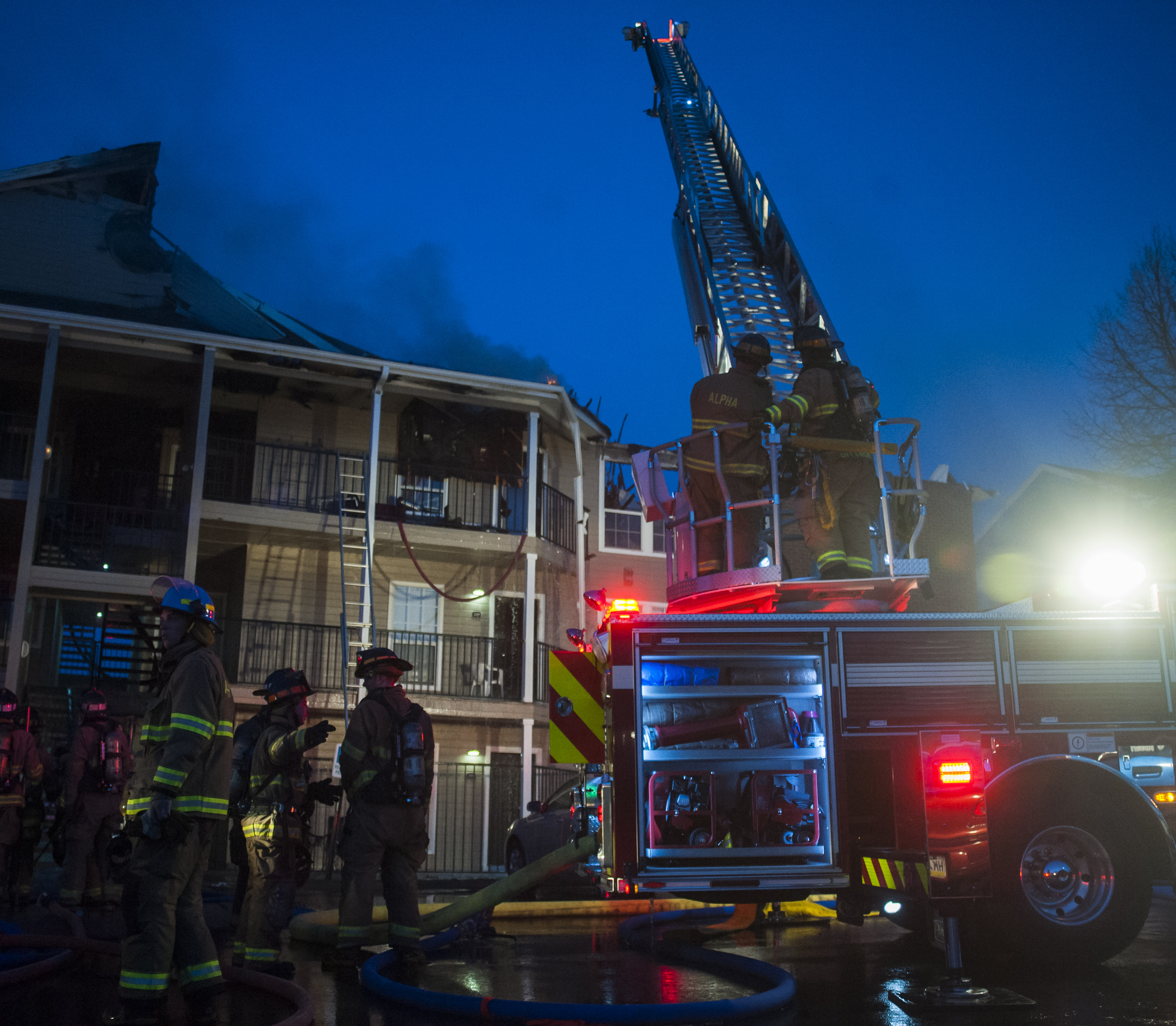 Members of Alpha Fire Co. work on extinguishing and clearing building 14 of The Park Apartments on Wednesday, April 20, 2016.