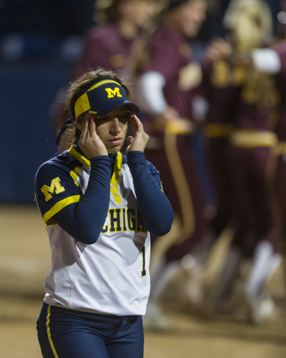 Michigan second baseman Abby Ramirez walks off of the field after the 4-3 loss to Minnesota in the bottom of the 10th inning of the final game of the Big Ten Tournament at Beard Field on Saturday, May 14, 2016.