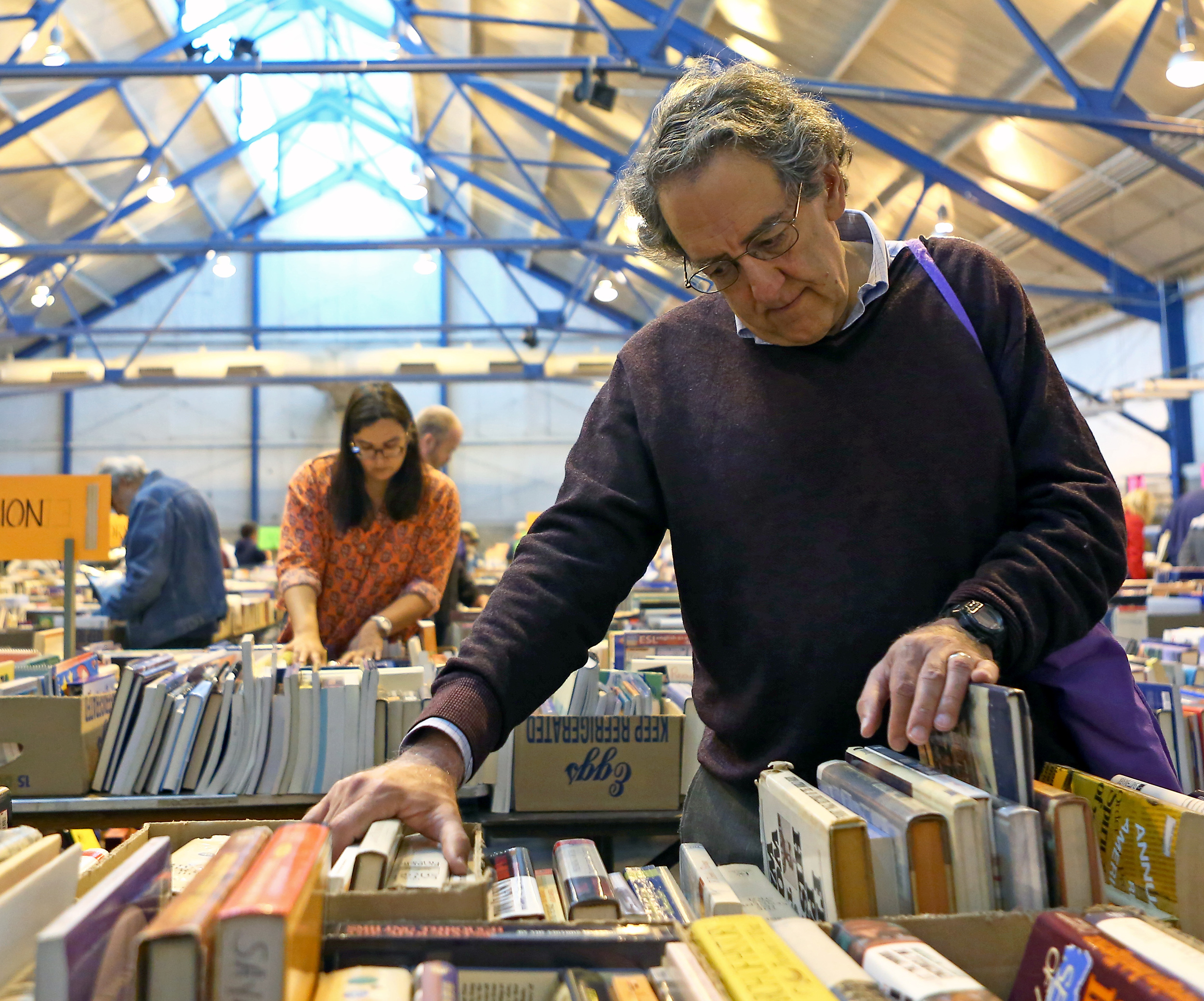 Barry Ruback of State College browses through the history section of the annual AAUW used book sale held at the Snyder Agricultural Arena on Sunday, May 15, 2016.