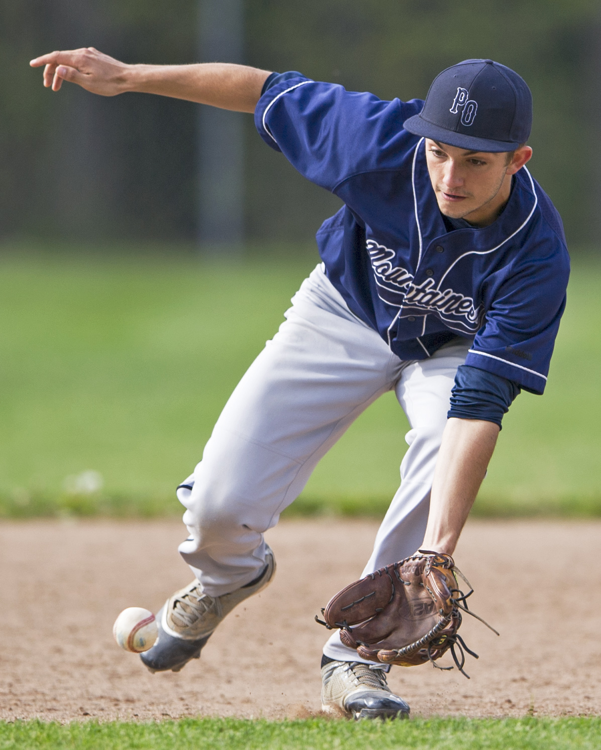 Phillipsburg-Osceola shortstop Logan Williamson leans for a ground ball during the home playoff game against Chestnut Ridge on Thursday, May 19, 2016. Phillipsburg won the game 4-3 in extra innings.