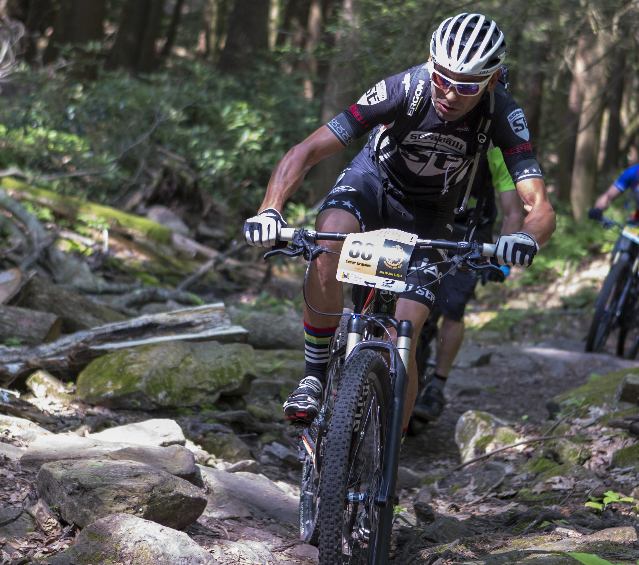 Stradalli team rider Cesar Grajales navigates the rocks in Shingletown Gap during the third stage of the Tran-Sylvania Epic Mountain Bike Ride on Wednesday, June 1, 2016.