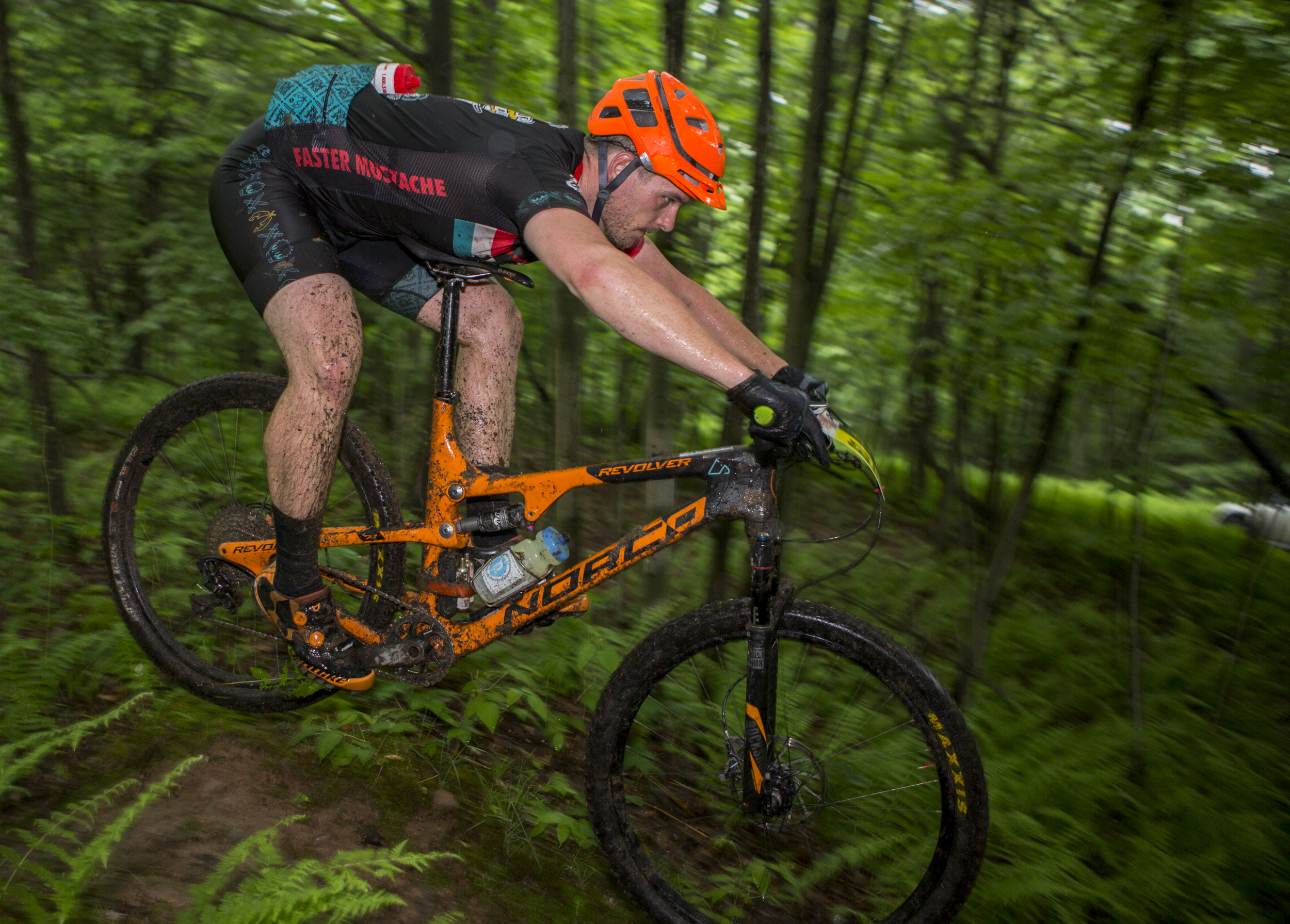 Aaron Chamberlain catches some air on a small dirt jump in the third enduro section in the final stage of the Tran-Sylvania Epic Mountain Bike Ride on Friday, June 3, 2016.