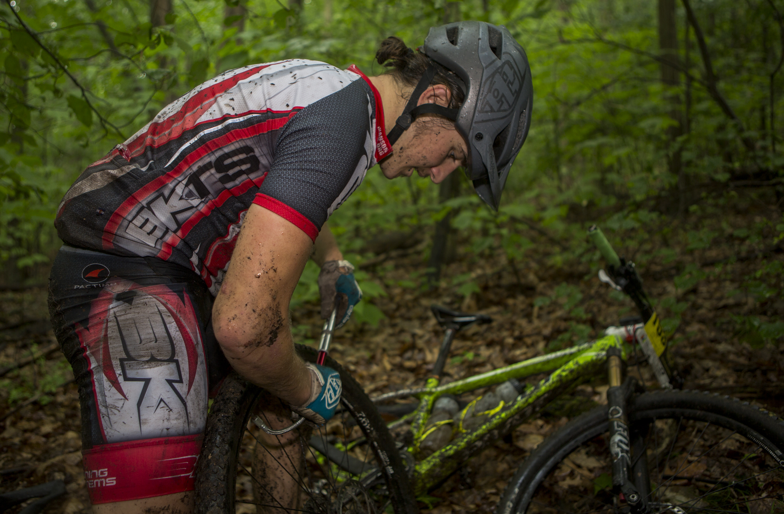 CJ Brish pumps up his rear tire after changing a punctured inner tube on the fourth enduro section of the final stage of the Tran-Sylvania Epic Mountain Bike Ride in Rothrock State Forest on Friday, June 3, 2016.