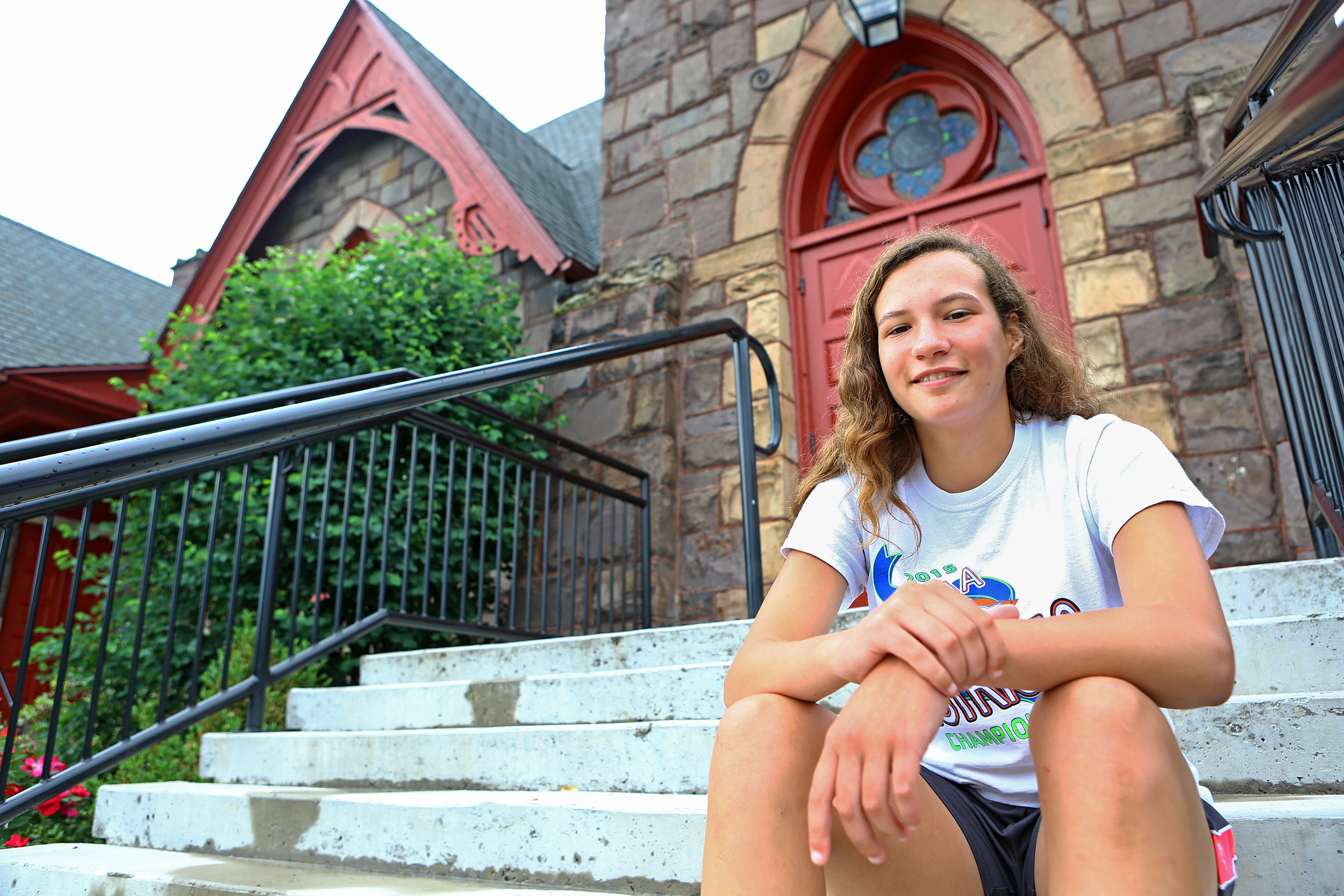 Penns Valley rising junior Alexis Witherite poses for a photo on the steps of Trinity United Church of Christ on Sunday, June 5, 2016. Witherite will be leading a mission group to Guatemala to build brick stoves and replant trees.