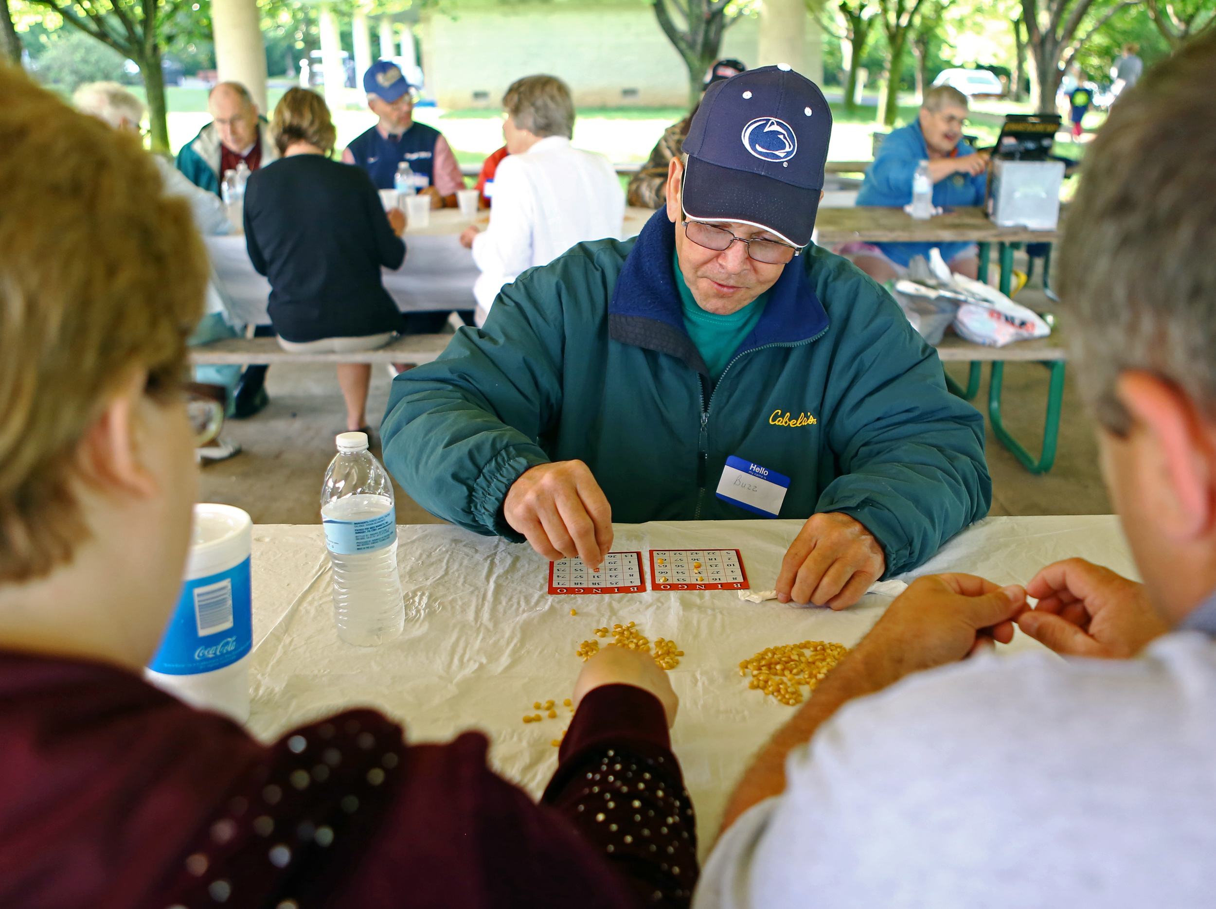 Cancer survivor Buzz McGee places popcorn kernels on on a bingo card during the Cancer Survivors Association picnic held at Tom Tudek Memorial Park on Sunday, June 5, 2016. McGee has been free of non-hodgkin's lymphoma for five years.