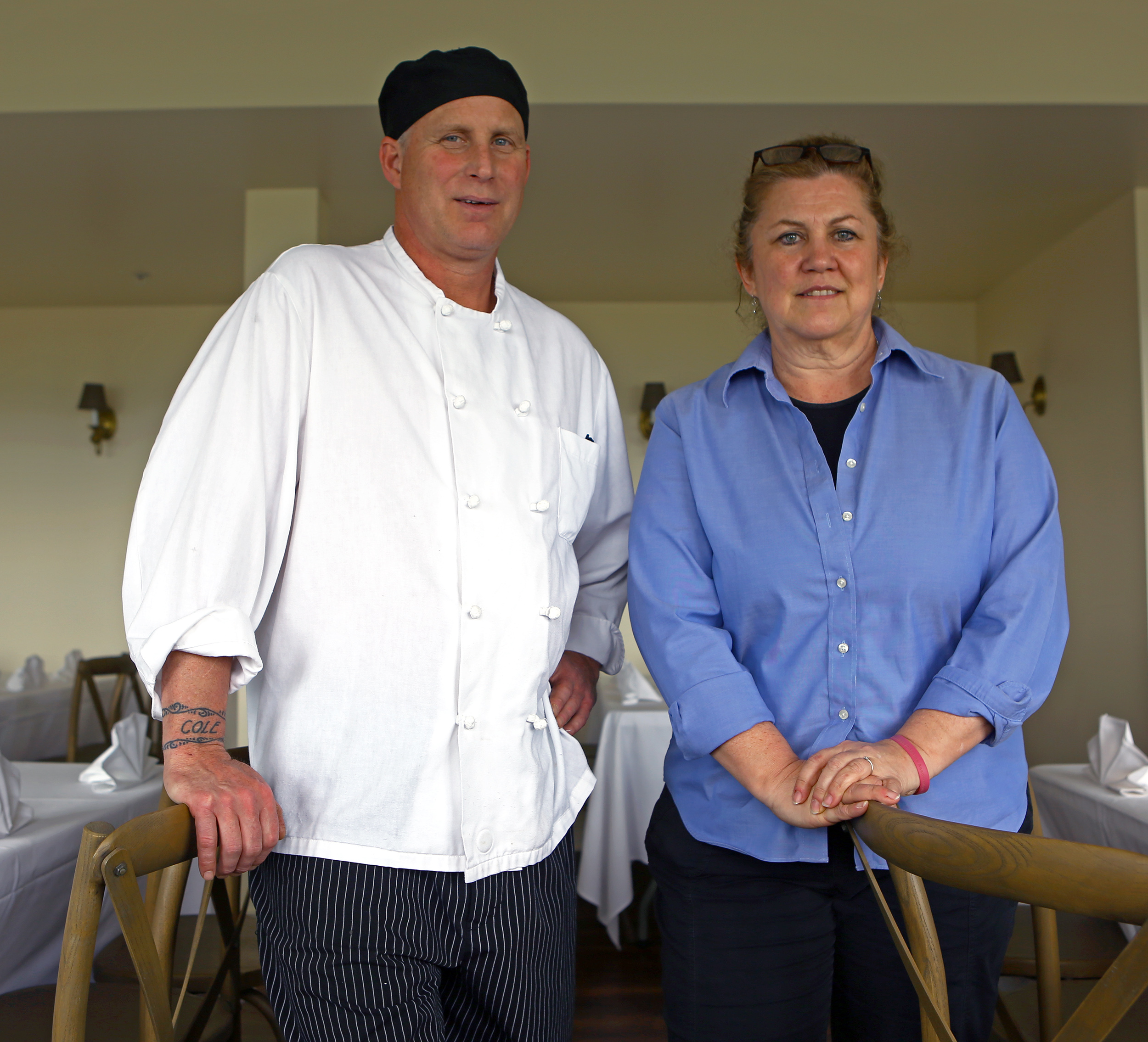 Co-owners of Harrison's Catering Harrison Schailey, left, and Kit Henshaw pose in the main dining room of Above the Valley, the company's new event center located on North Pennsylvania Avenue in Centre Hall over looking Penns Valley on Wednesday, June 8, 2016.