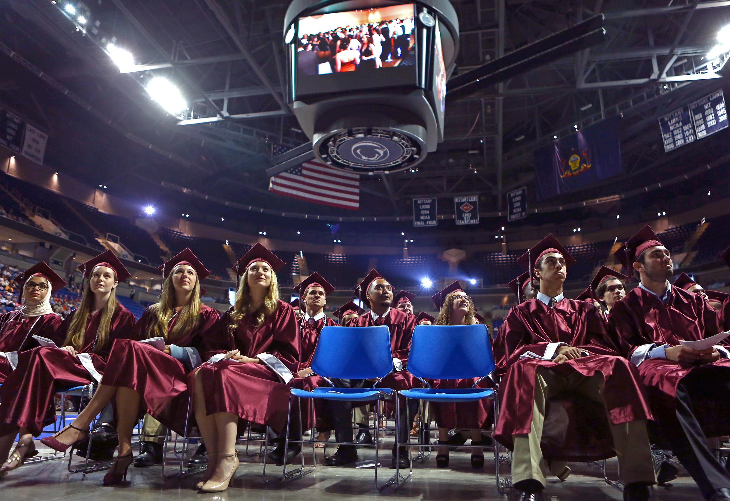 State College Area High School graduates watch the senior class video during the commencement ceremony at the Bryce Jordan Center on Saturday, June 11, 2016.