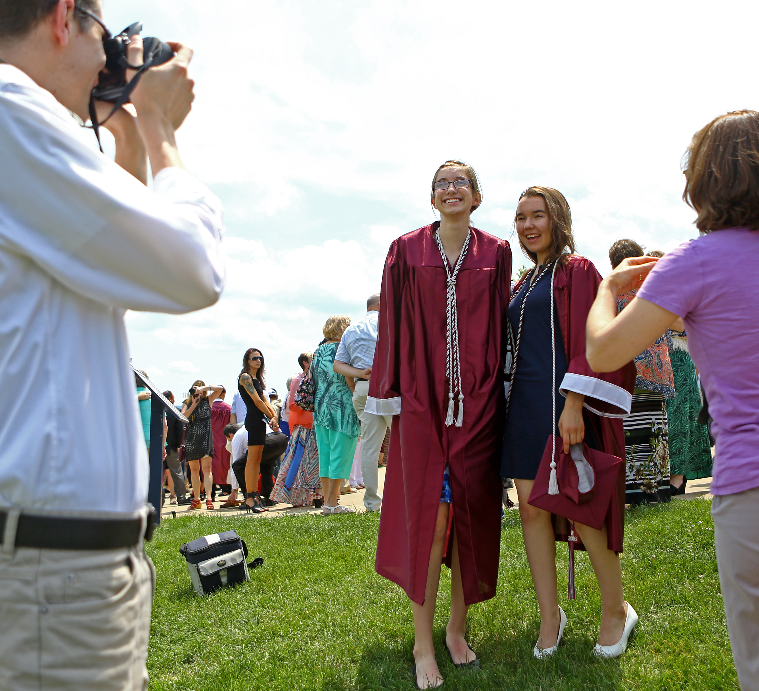 Bethany Parkinson, left, and Natalie Farnsworth, right, pose ofr photos outside of the Bryce Jordan Center following the State College Area High School commencement ceremony on Saturday, June 11, 2016.