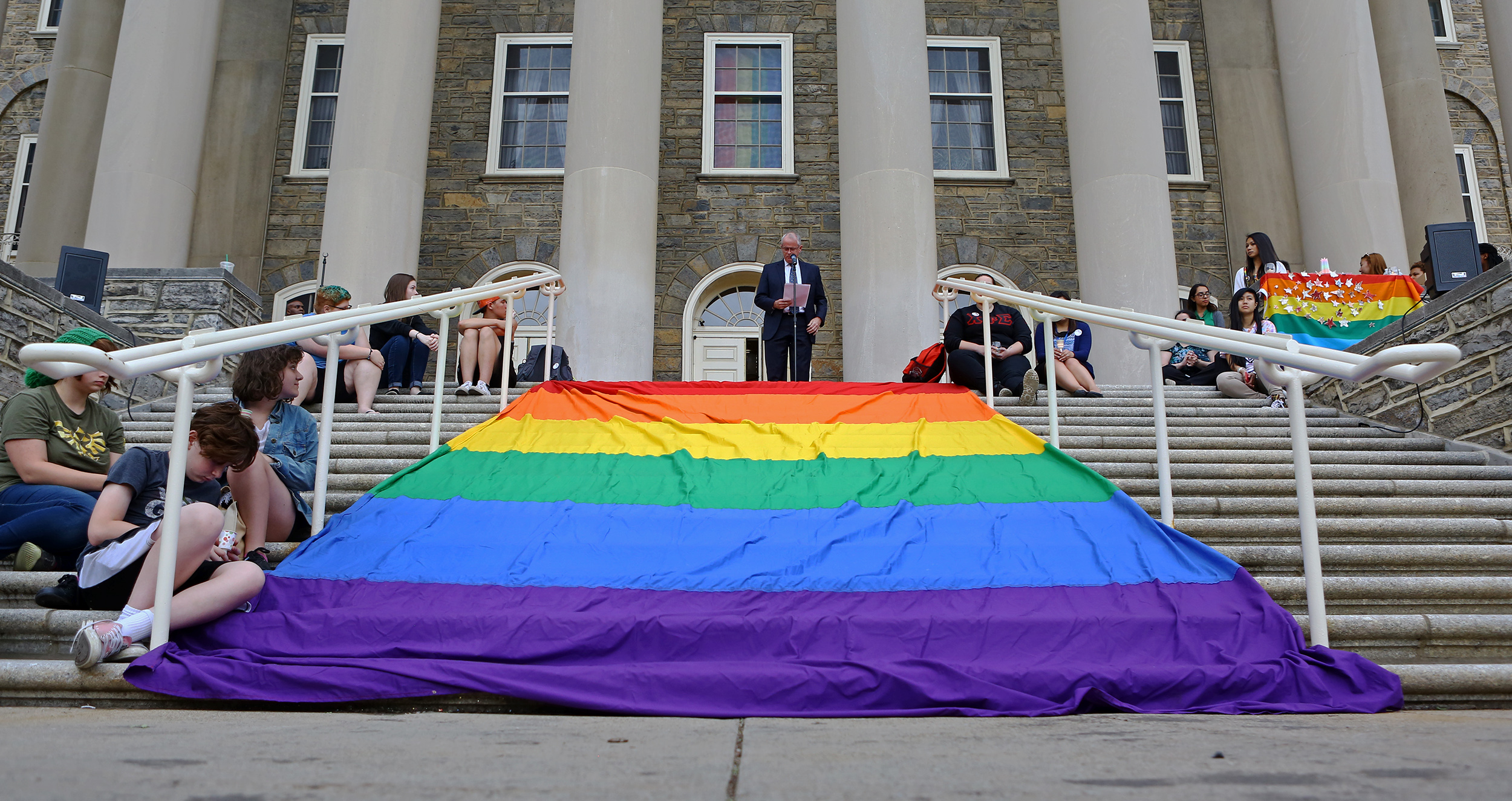Penn State executive vice president and provost Nick Jones speaks on the steps of old main during the candle light vigil honoring the Orlando, Florida shooting victims on Monday, June 13, 2016.