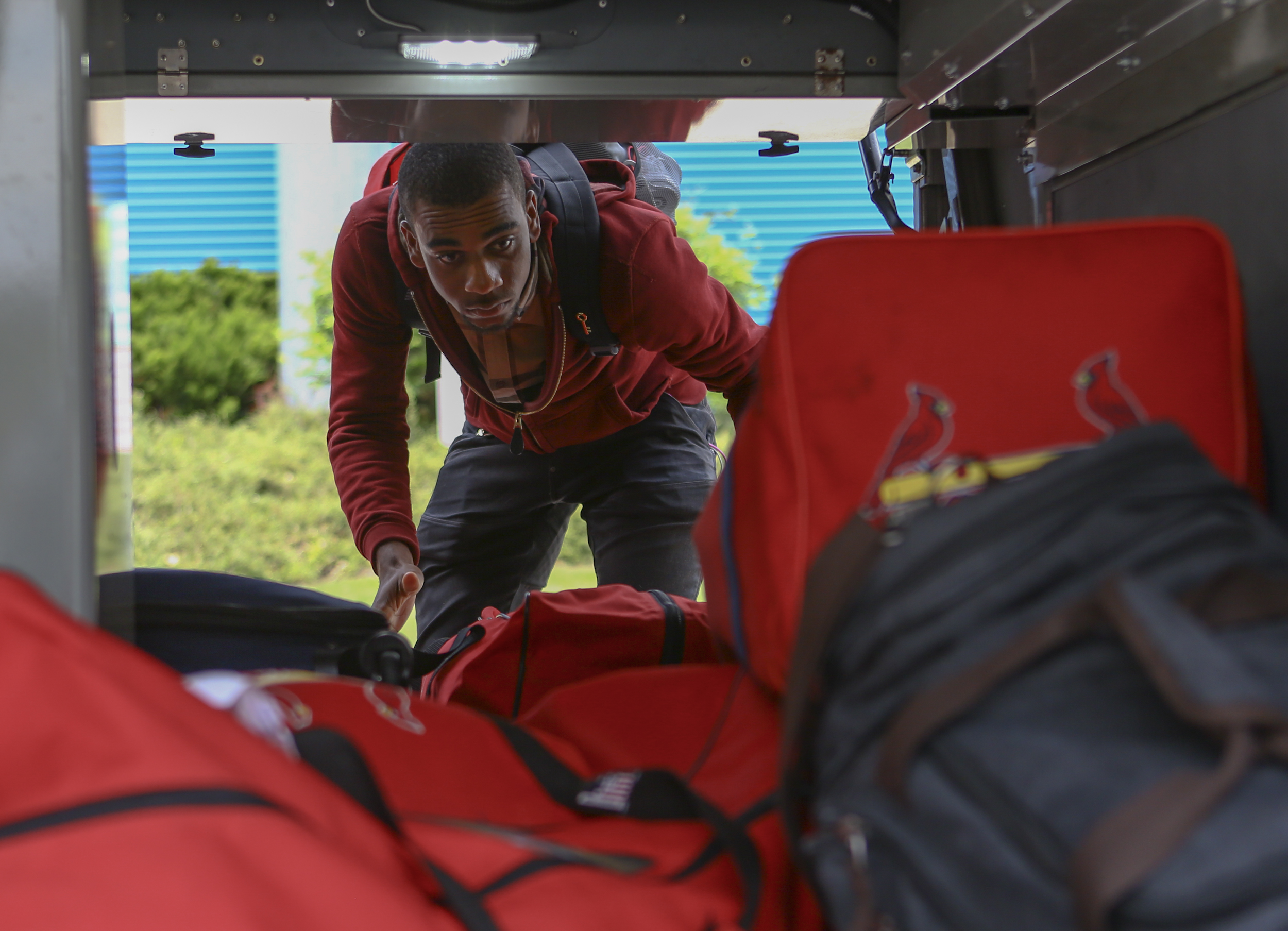 State College Spikes pitcher Jhonatan Escudero grabs luggage from the bus during the team's arrival to State College at medlar Field on Saturday, June 11, 2016.