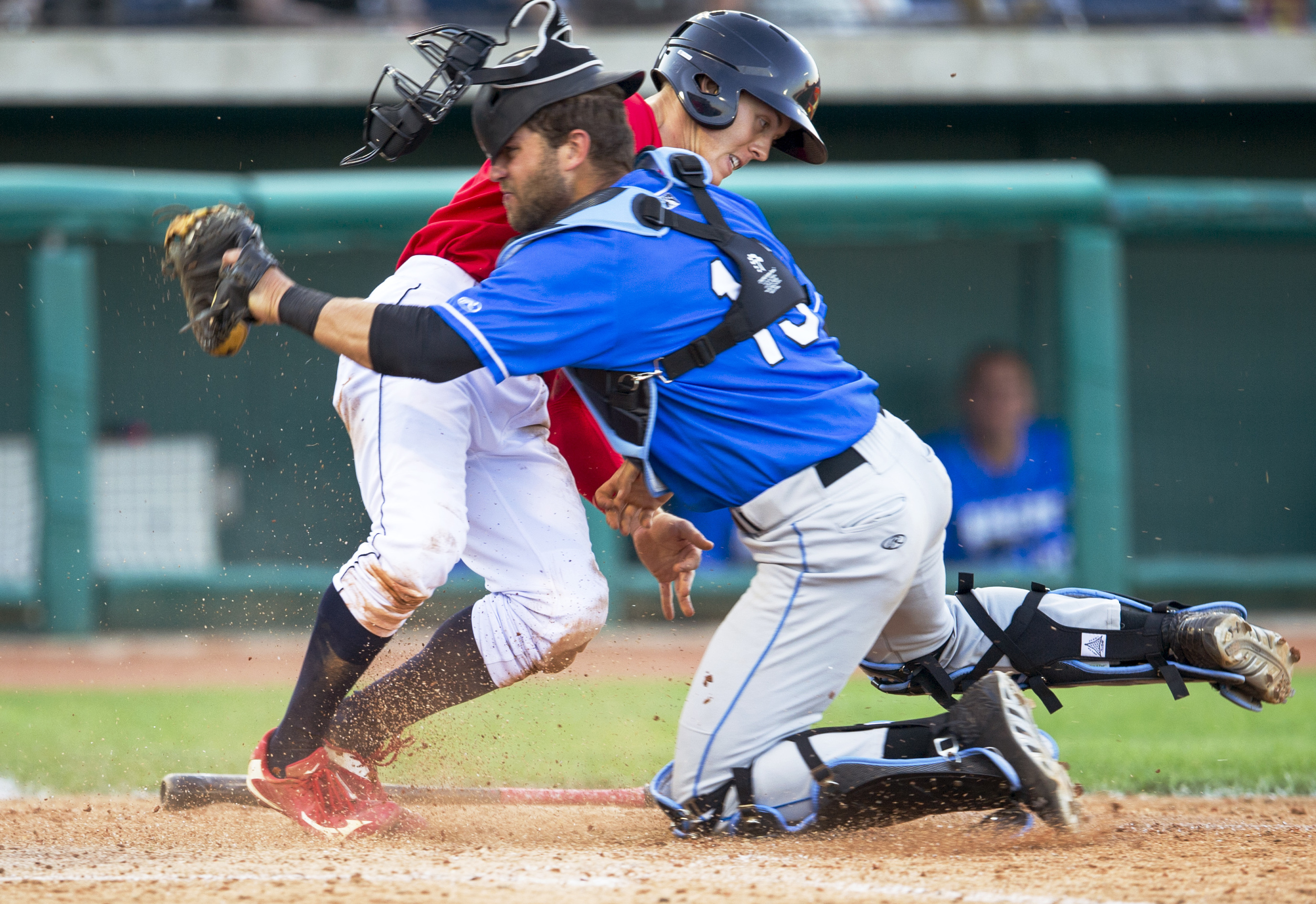 State College Spikes second baseman Danny Martin collides with Hudson Valley Renegades catcher Daniel De La Calle to tie the game in the bottom of the seventh inning during the game at Medlar Field on Sunday, June 19, 2016. State College won the game 7-6.