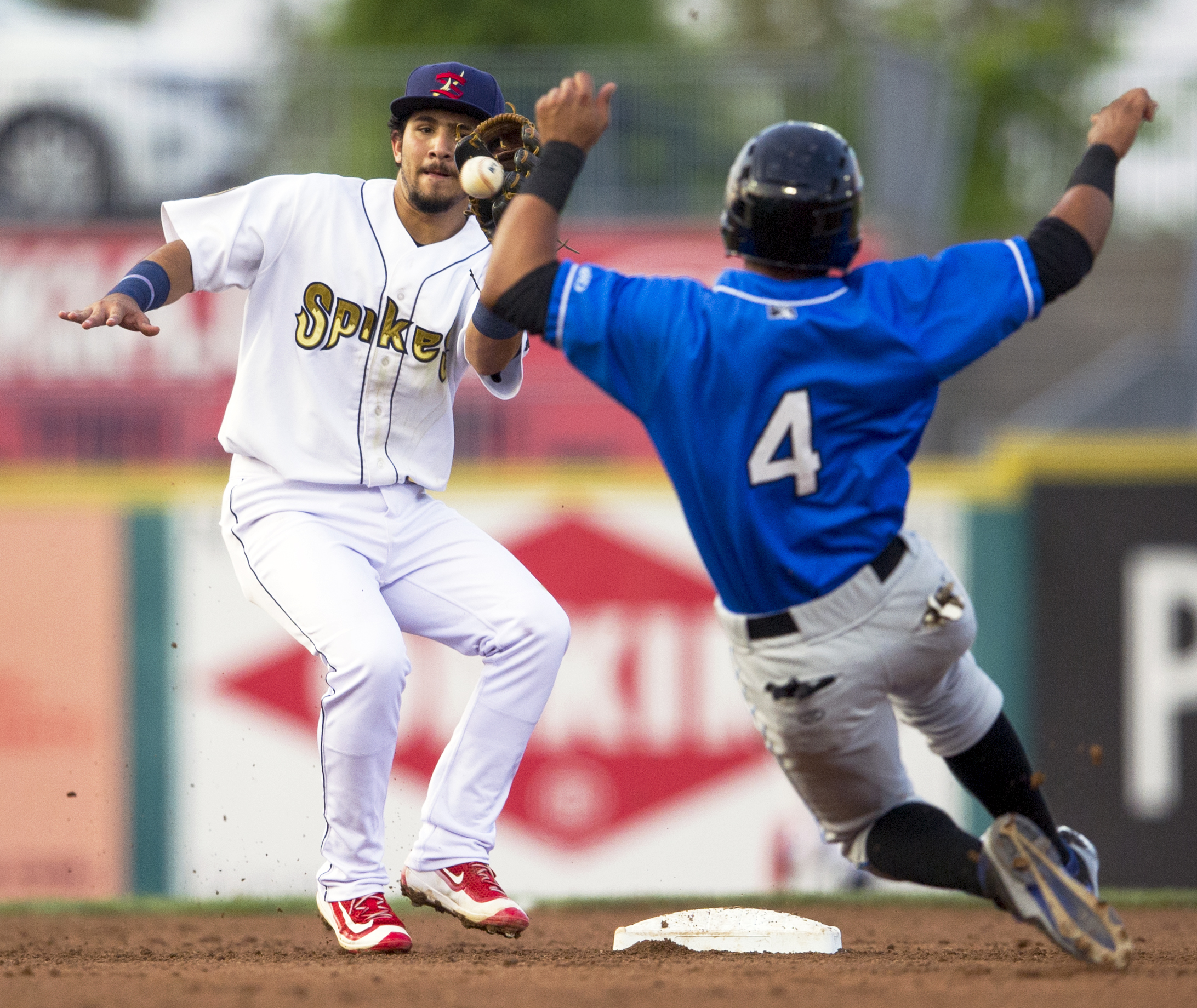 State College Spikes short stop Jose Martinez catches the ball to tag out Hudson Valley Renegades center fielder Oscar Rojas as he slides to second base during the second game of the series at Medlar Field on Monday, June 20, 2016.