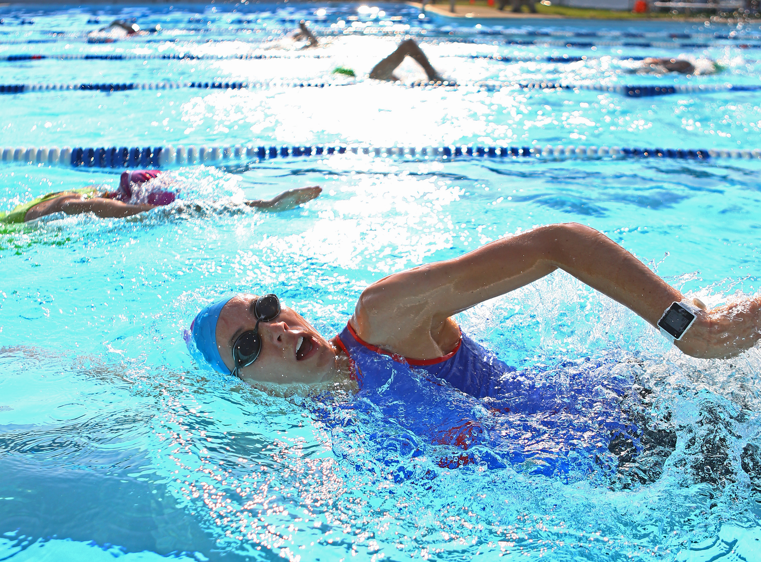 Allison Saunders of Williamsport takes a breath while swimming in the first portion of the Millheim Pool Sprint Triathlon in Millheim Pool on Saturday, June 25, 2016.