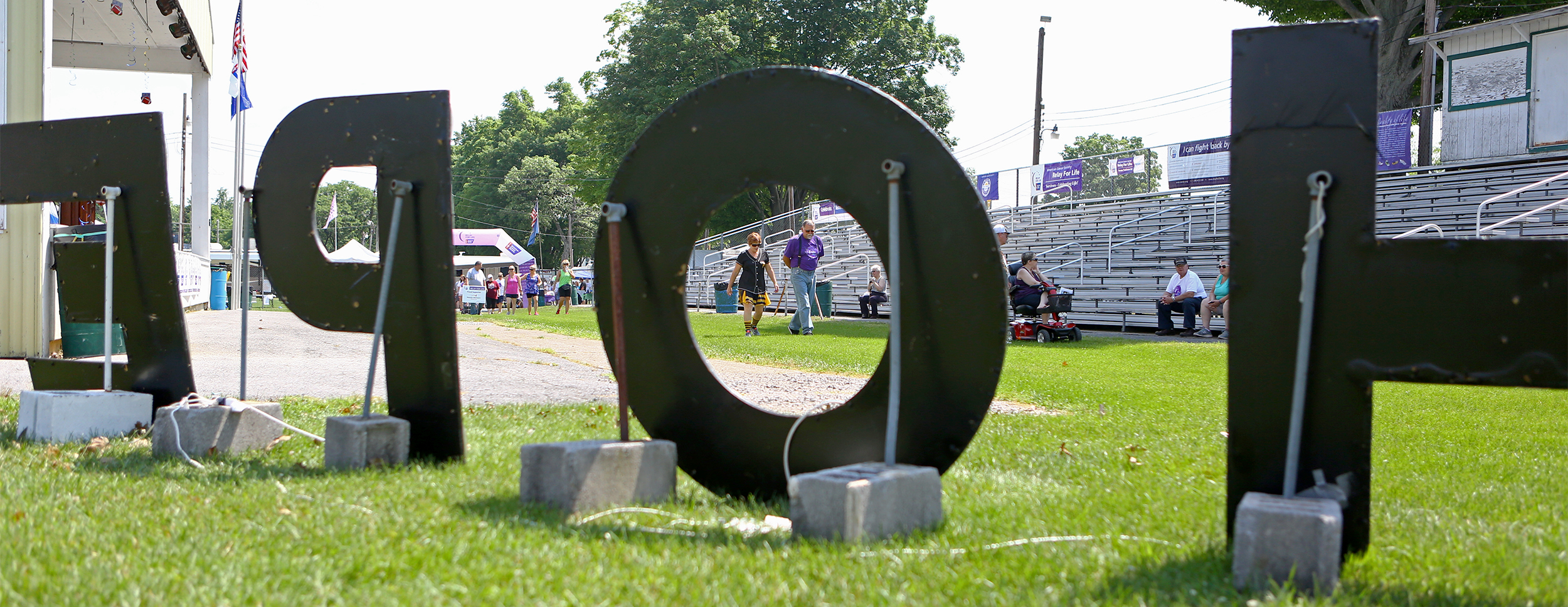 """A large illuminated """"Hope"""" sign is set up next to the Grange Fair Grounds for Happy Valley Relay for Life participants to see as they walk the grounds for the next 24 hours to fundraise for cancer research on Saturday, June 25, 2016."""