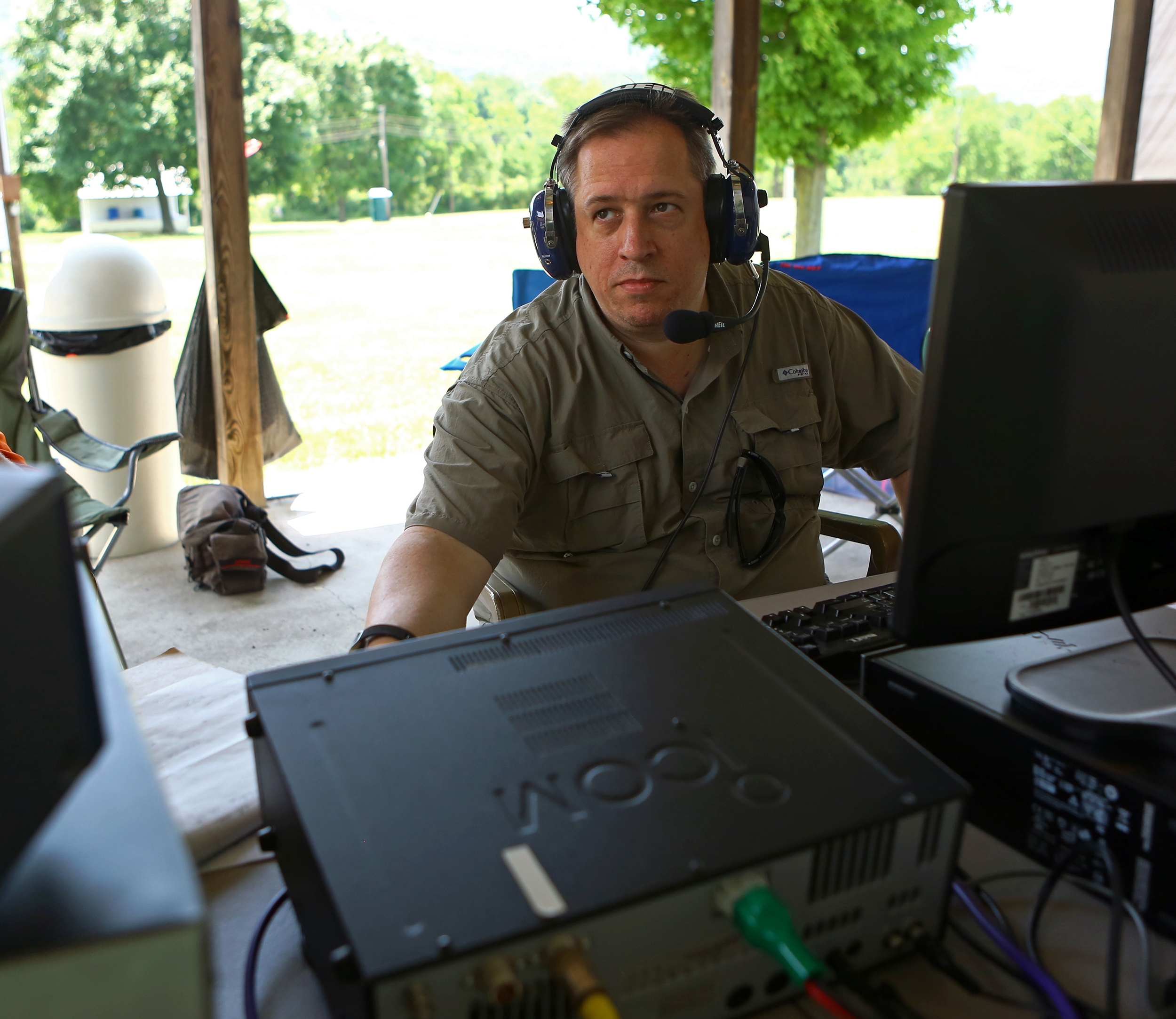 Dave Ritz, call sign NK3X, of State College listens in on the 40 meter band for potential contacts to make during the Nittany Amateur Radio Club's field day at the Pleasant Gap Fire Company carnival grounds on Sunday, June 26, 2016.