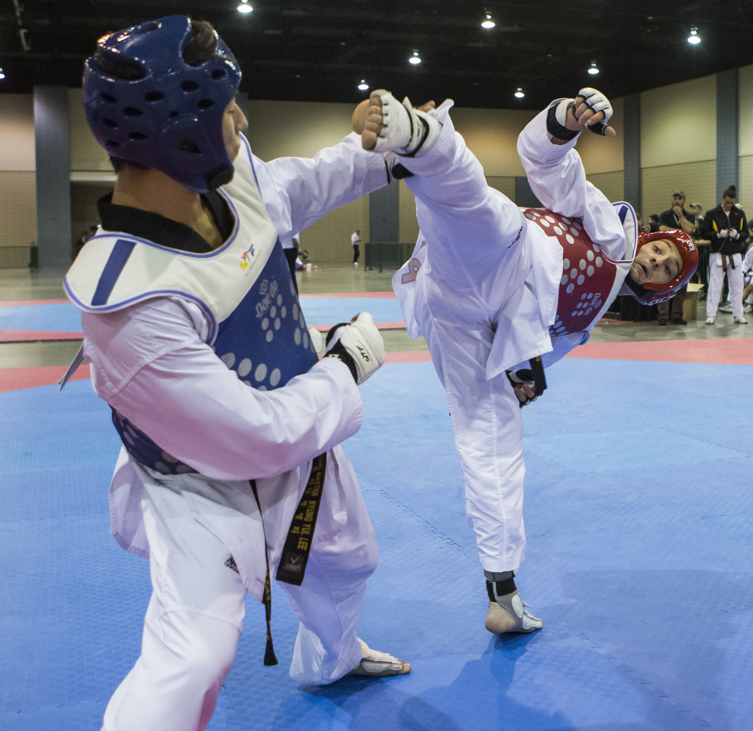 Travis Wissbroecke dodges a high kick from Matt Gallagher during a sparring match as part of the USA Taekwondo National Championships held at the Greater Richmond Convention Center in Richmond, Va. on Thursday, July 7, 2016.