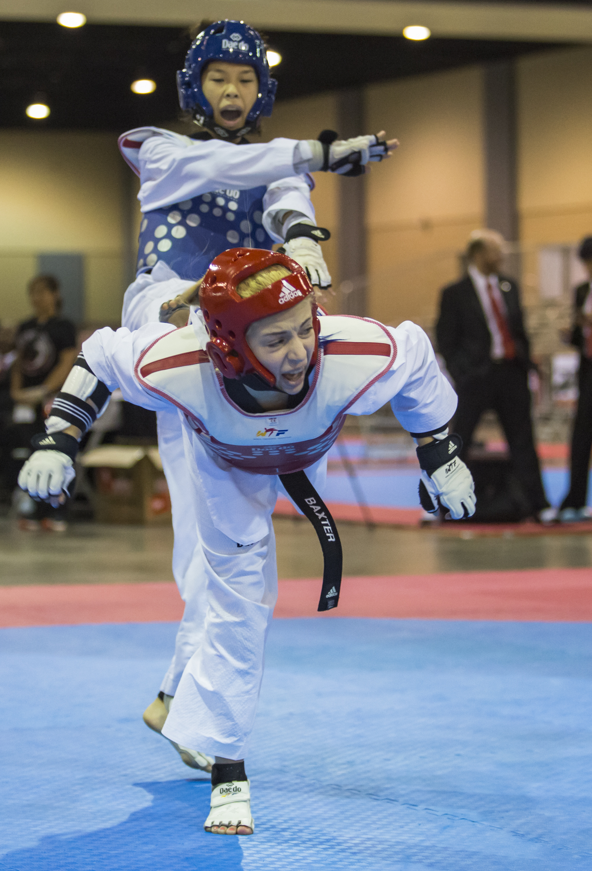 Olivia Baxter delivers a spin kick to Marissa Mahanag's chest in the 37-41 kilogram black belt final match up during the USA Taekwondo National Championships held at the Greater Richmond Convention Center in Richmond, Va. on Saturday, July 9 , 2016.