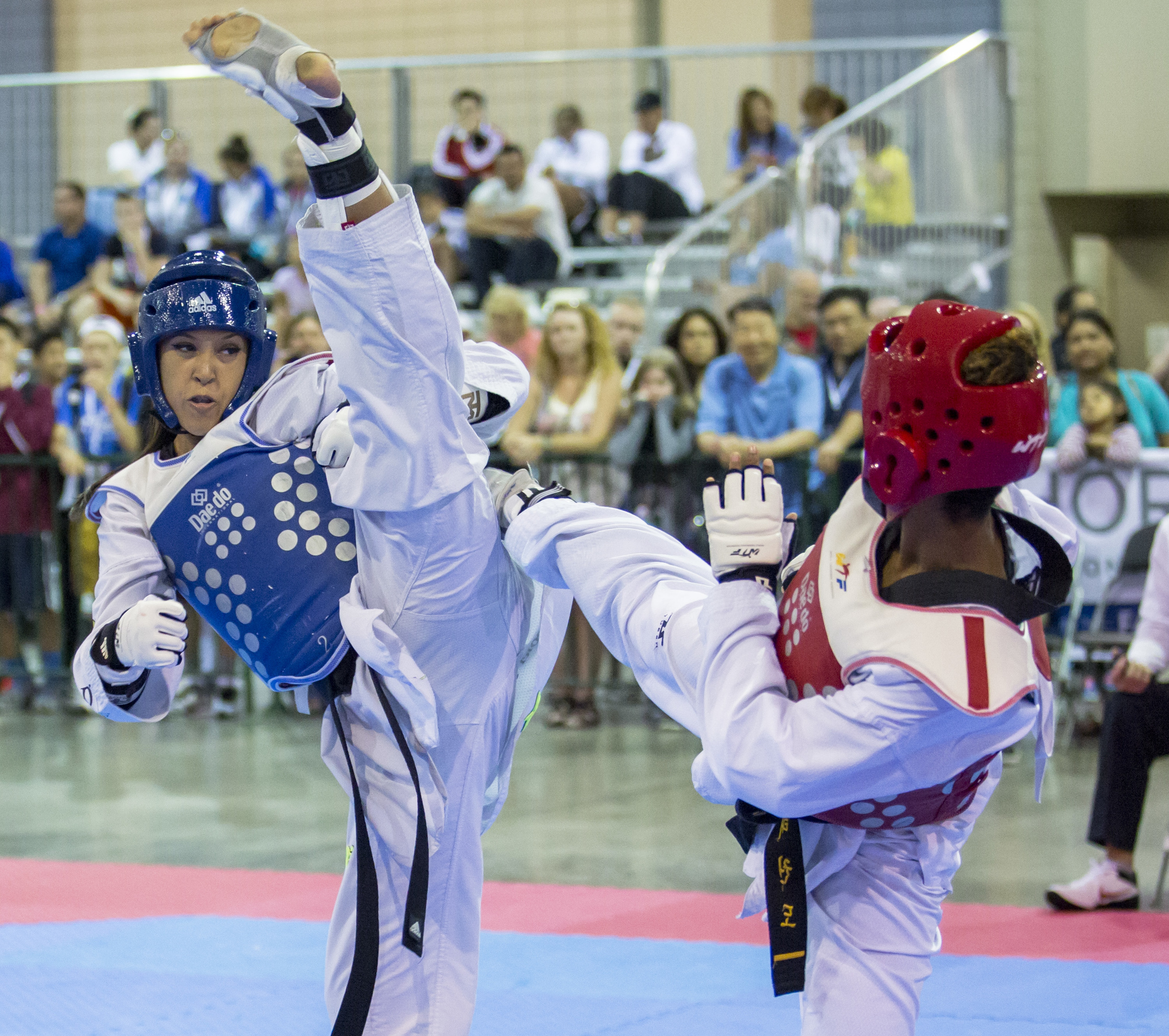 Cassie Tubbs extends for a high kick in her bout against Starla Santana during the USA Taekwondo National Championships held at the Greater Richmond Convention Center on Sunday, July 10, 2016.