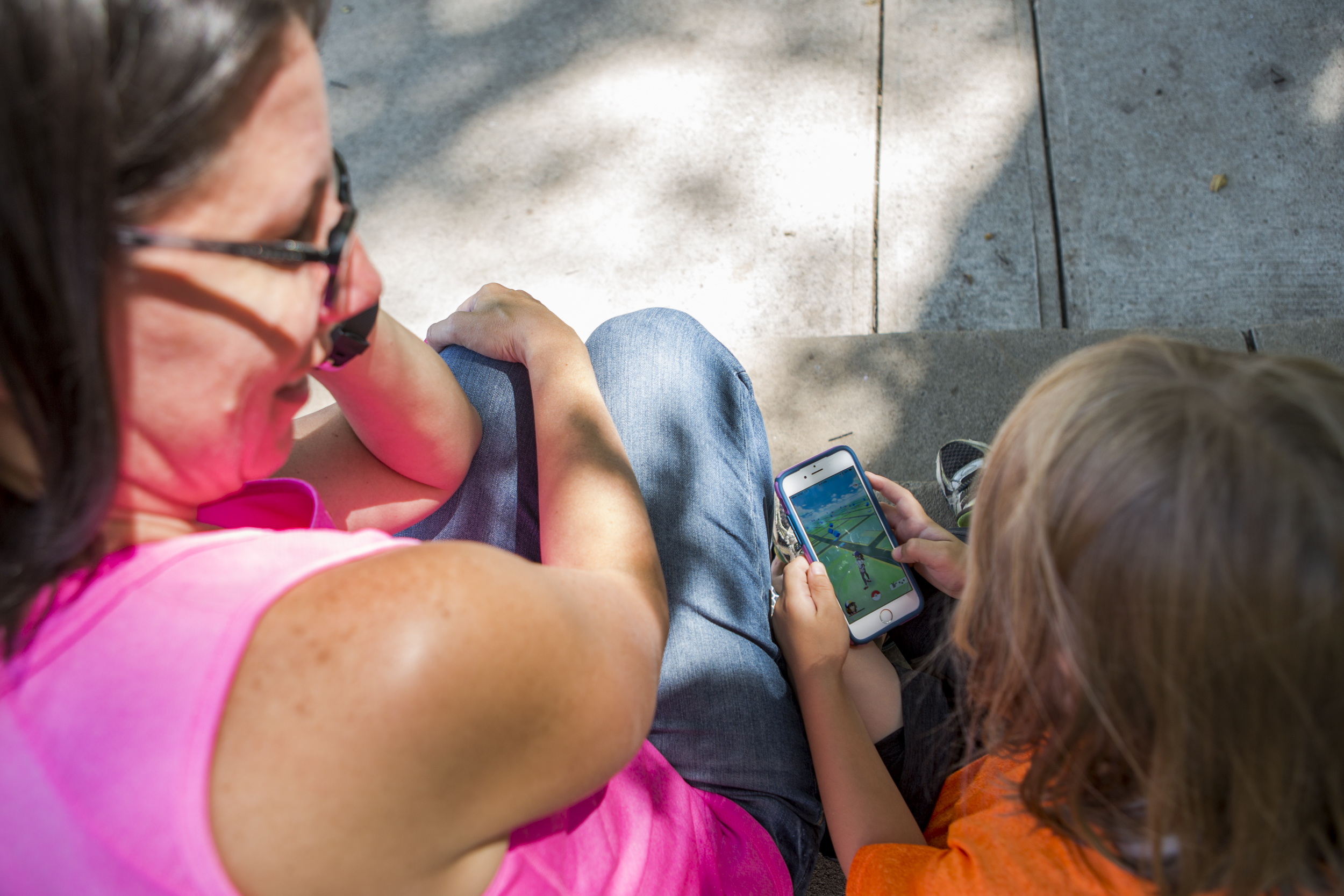 Marcia DiStaso accompanies six-year-old son Matthew DiStaso on the hunt for a Pikachu along side of several other Pokémon Go players on the steps of Old Main on Penn State's campus on Monday, July 18, 2016.