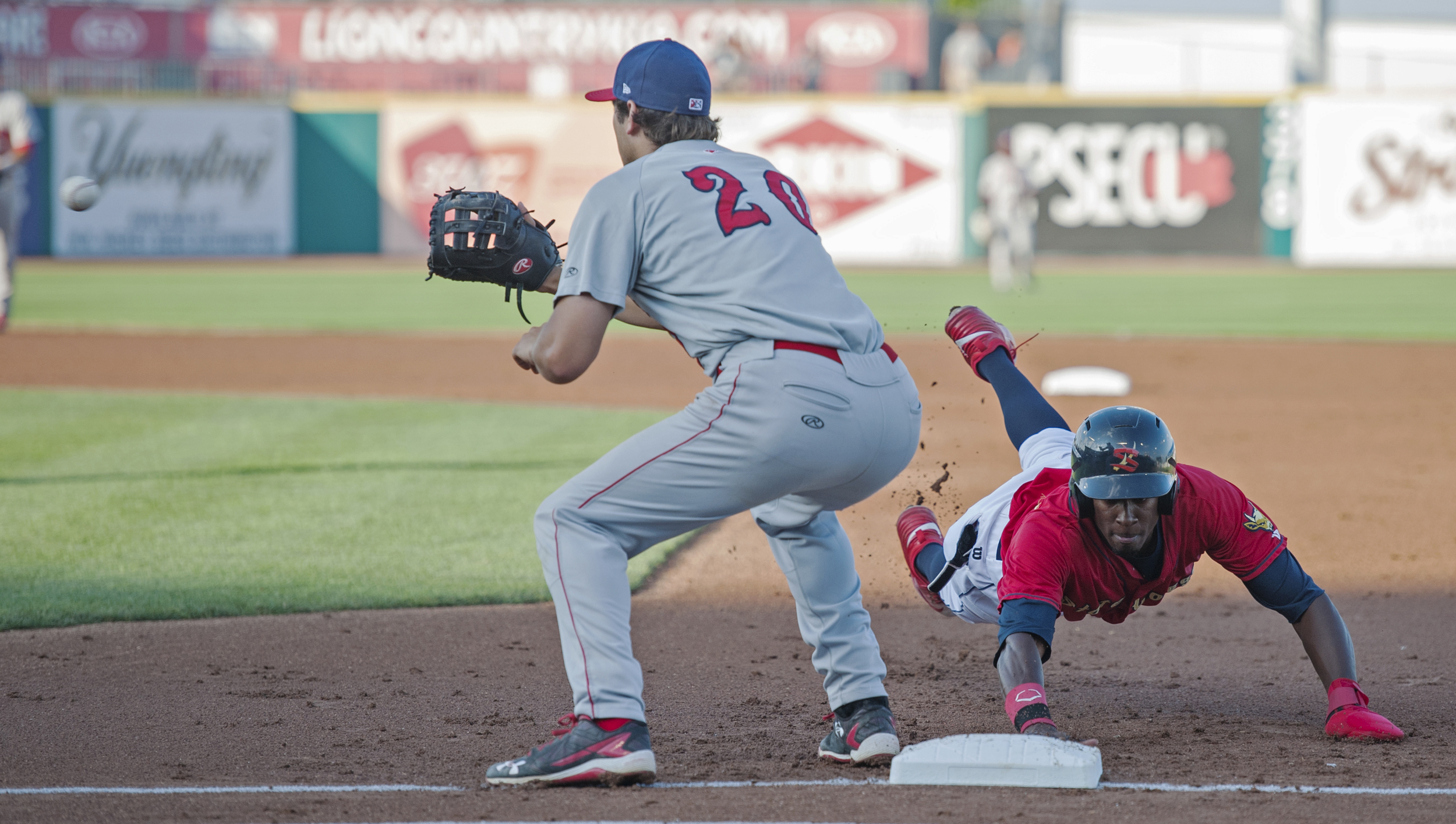 Auburn Doubledays first baseman Ryan Ripken turns to catch a throw from the pitcher as State College Spikes left fielder Vince Jackson dives back to first base after being caught trying to steal during the second game of their series at Medlar Field on Friday, July 22, 2016.