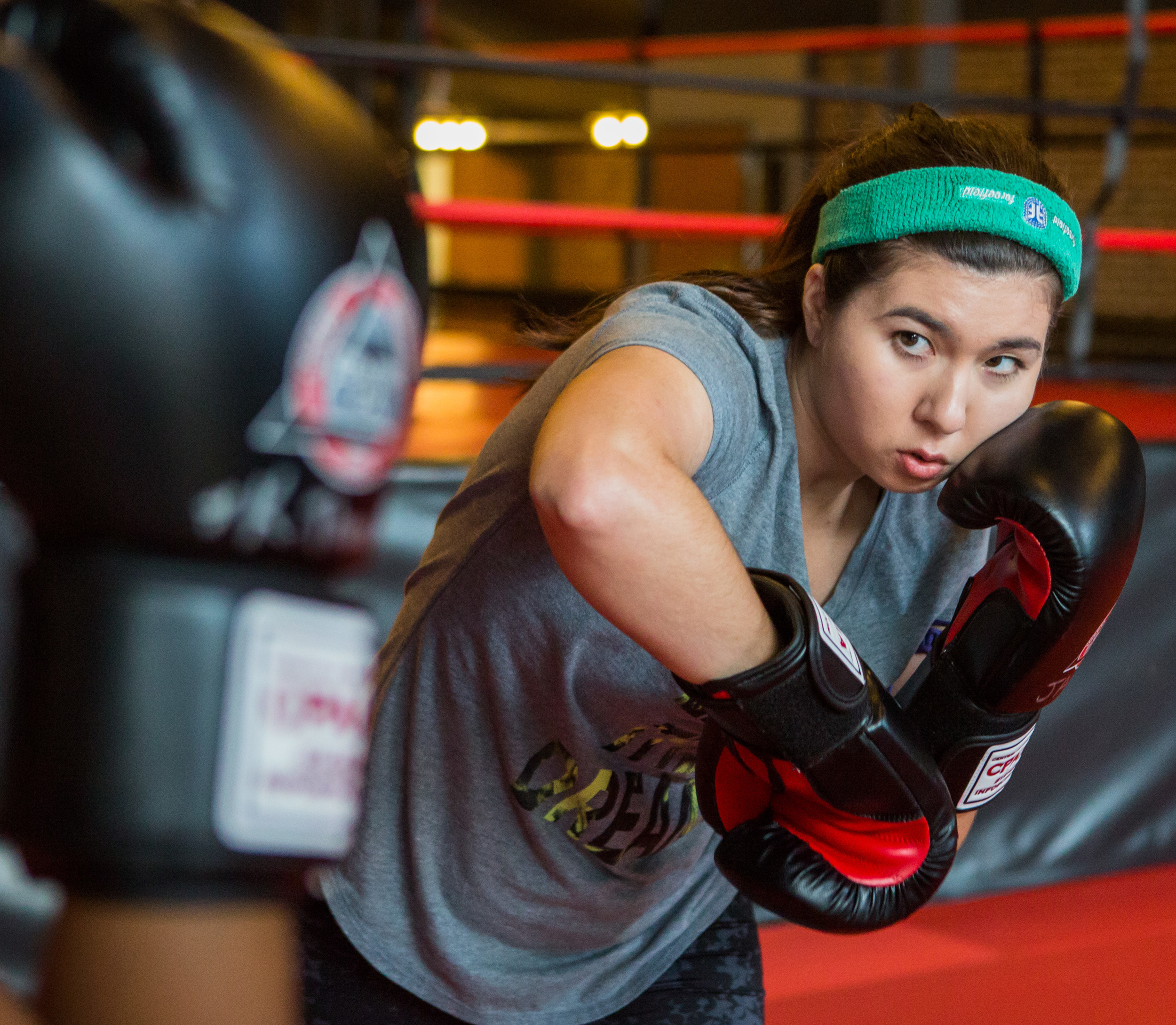 Jacqueline Demartino of State College spars with Kristen Thomas during women's only sparring day at Central PA Mixed Martial Arts in State College on Sunday, July 31, 2016.
