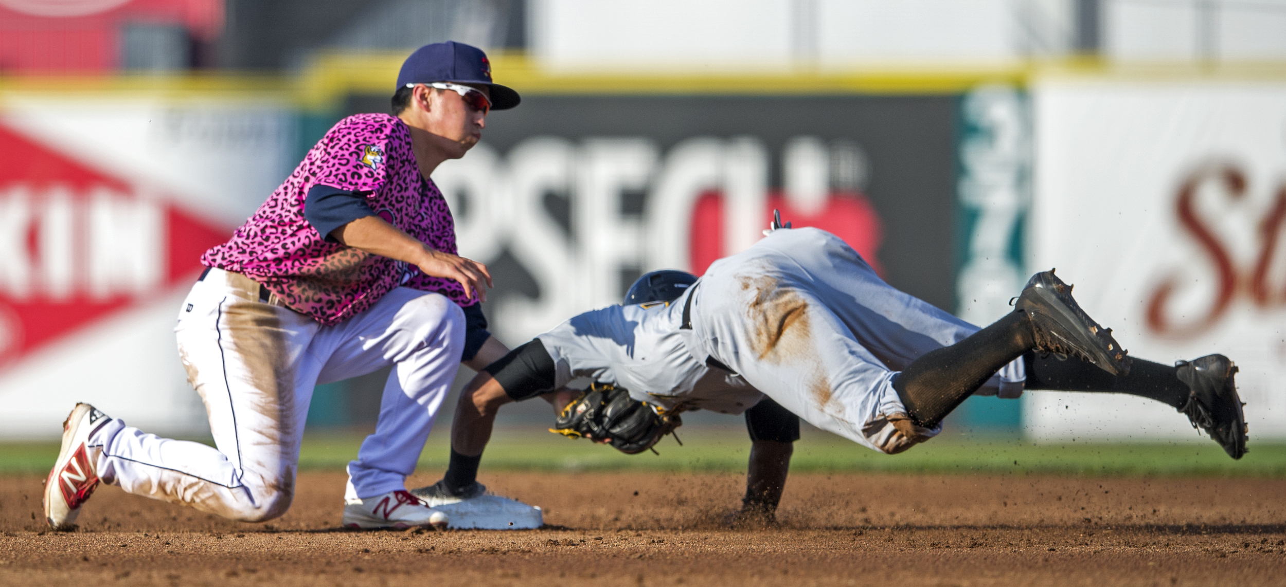 State College Spikes short stop Tommy Edman tags out West Virginia Black Bears center fielder Sandy Santos as he attempts to steal second base during the first game of their series at Medlar Field on Sunday, July 31, 2016.