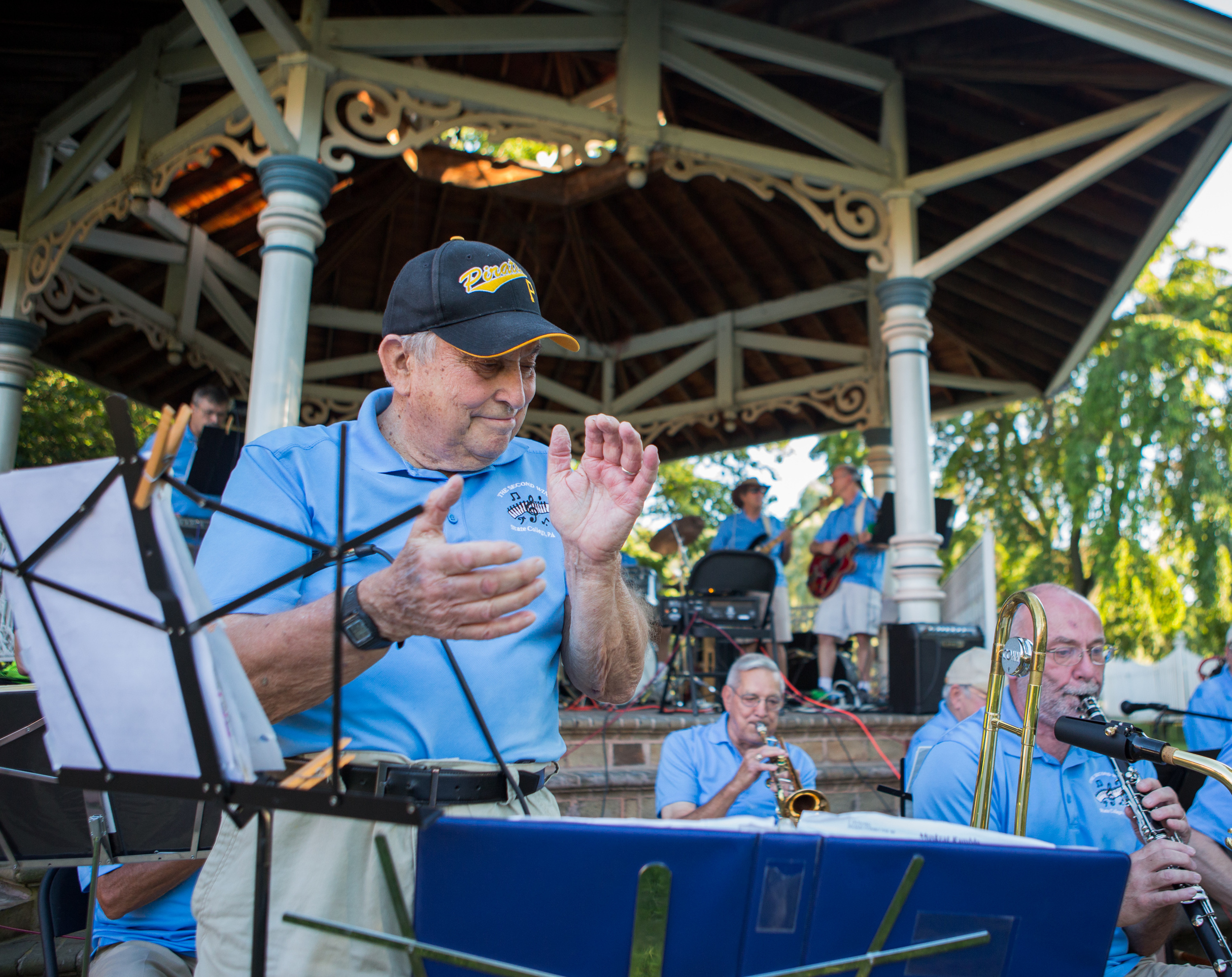 """Theodore Elwood Fuller claps as and prepares to sing """"The Pennsylvania Polka"""" with The Second Winds as part of the weekly concert series at the gazebo in Talleyrand Park in Bellefonte on Sunday, Aug. 7, 2016."""