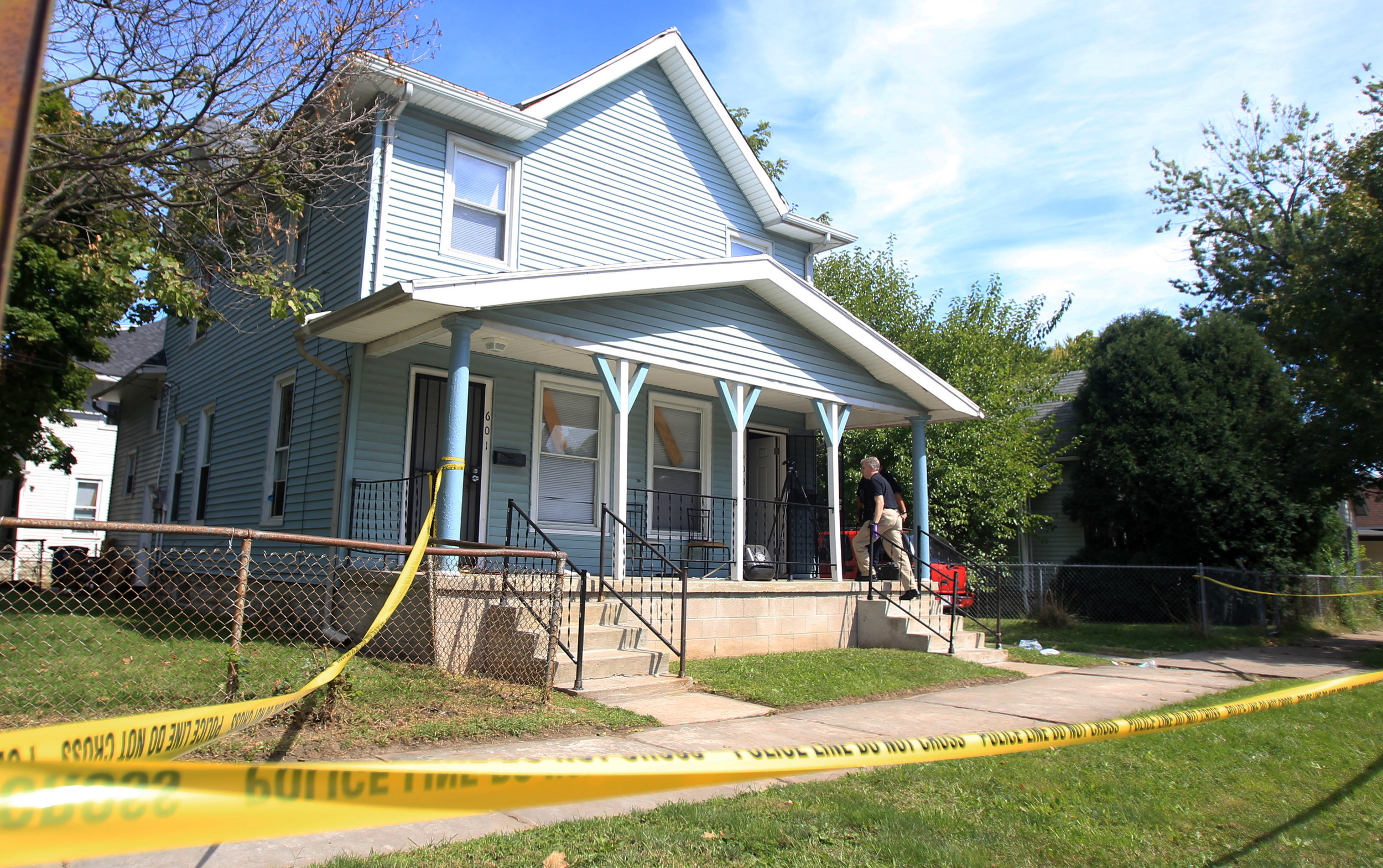 A Toledo Police Department investigator enters 603 Church Street in East Toledo to continue the investigation of the shooting in the morning of Thursday, Sept. 15 photographed on Thursday, Sept. 15, 2016.