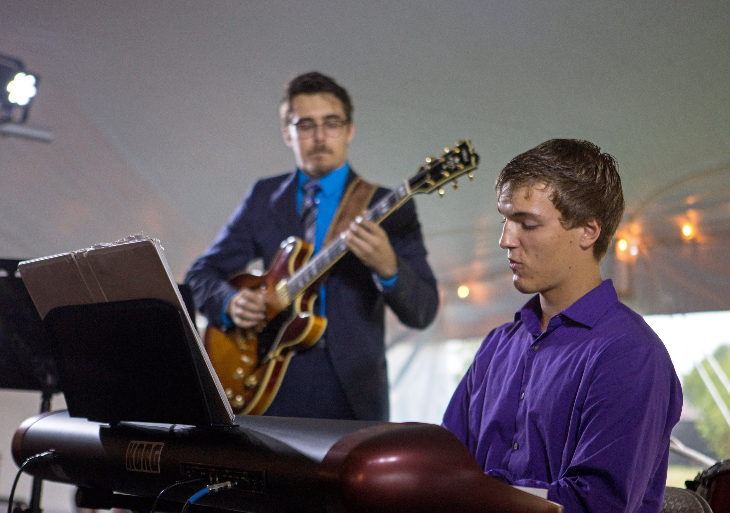 Toledo School for the Arts senior Ben Scheiber plays the keyboard with the Urban Jazz Collective during the opening of Middlegrounds Metropark in downtown Toledo on Saturday, Sept. 17, 2016.