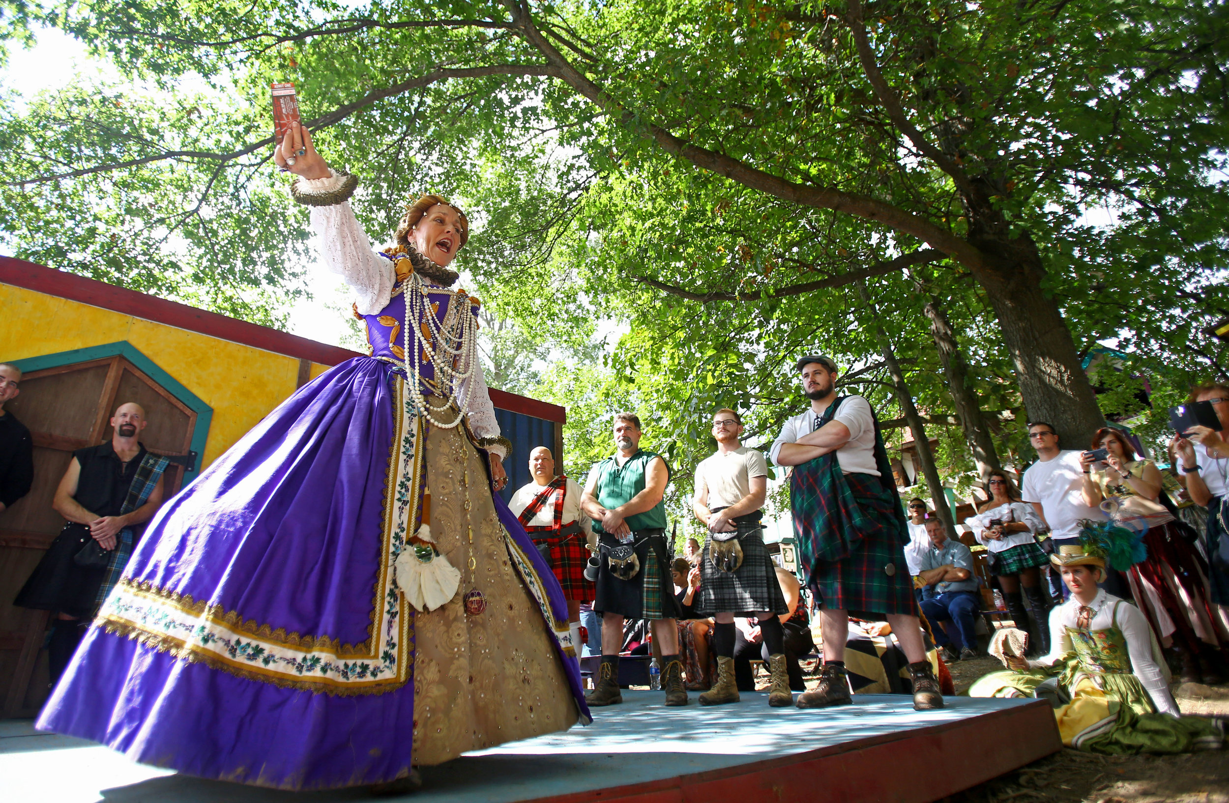 "The queen of the renaissance festival announces the winner of ""Men in Kilts"" competition at the Michigan Renaissance Festival in Holly Michigan on Sunday, Sept. 18."