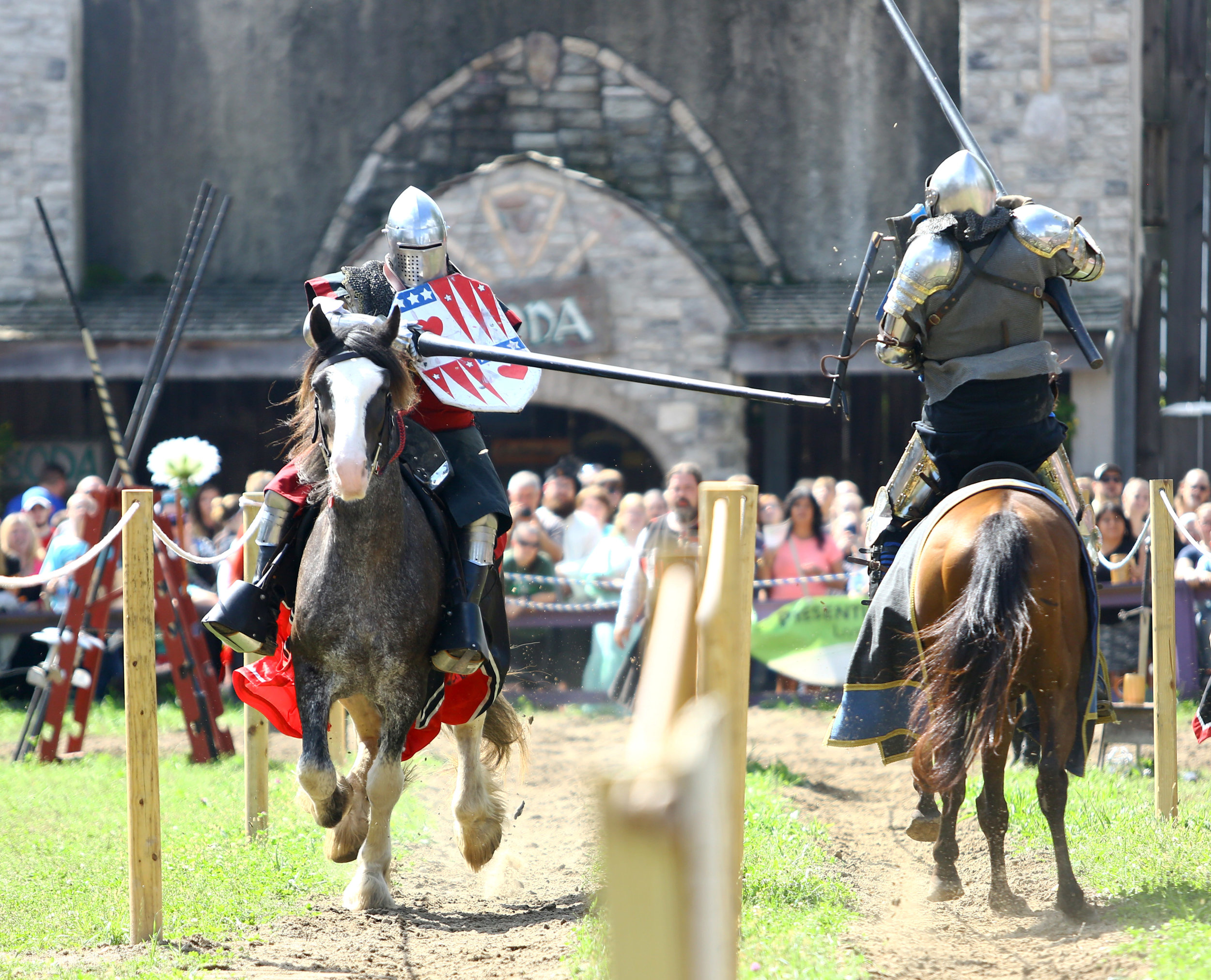 Dale Walter of Howell, Mi. breaks a lance on the shield of Kevin Statz of Hebbron, In. as part of the jousting demonstration at the Michigan Renaissance Festival in Holly Michigan on Sunday, Sept. 18.