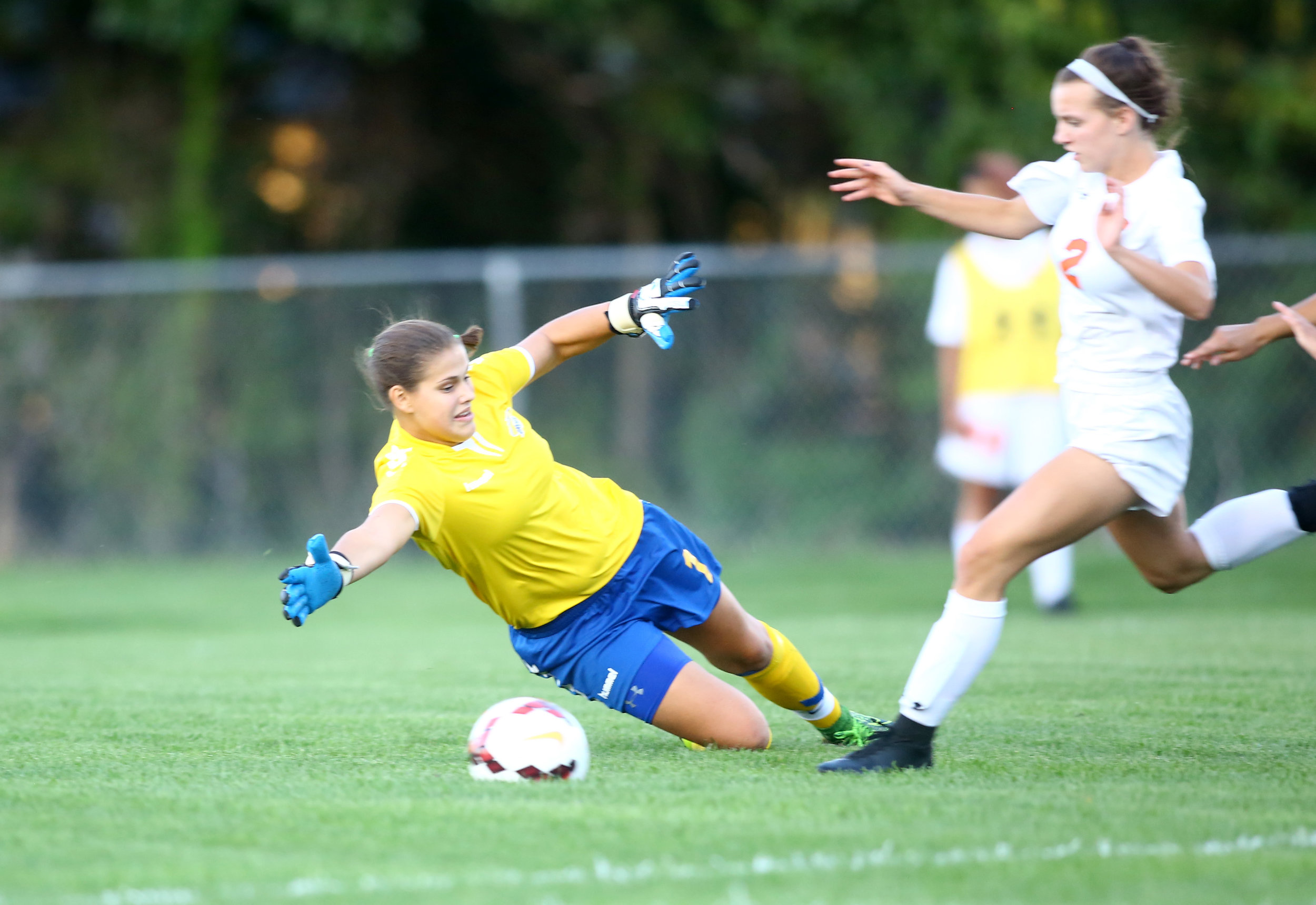 St. Ursula goalkeeper Katie Both dives in an attempt to block Southview High School forward Ellie Pool from scoring the first goal of the game at Southview High School in Sylvania on Monday, Sept. 19, 2016.