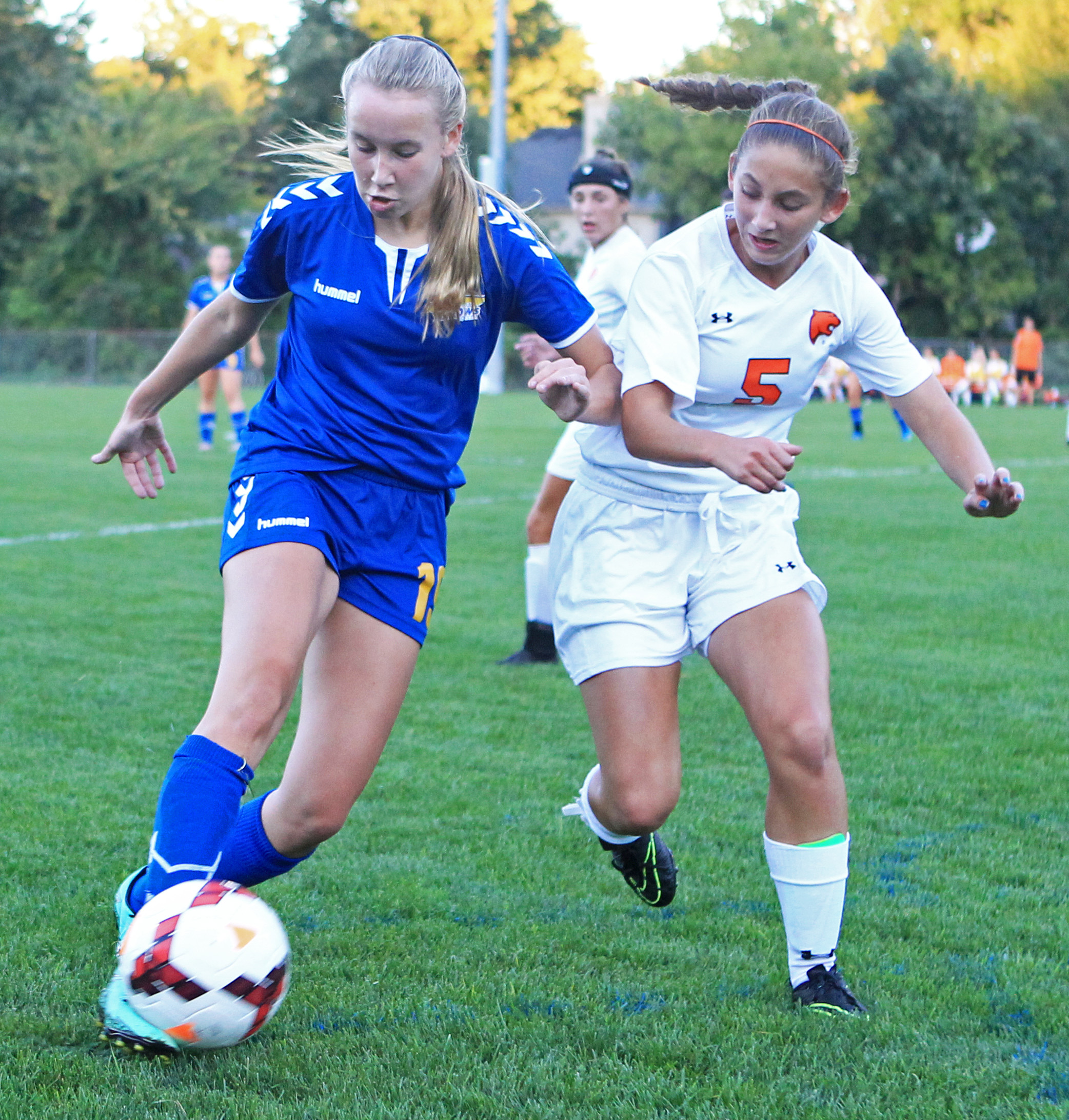 St. Ursula freshman defender Lily Turski tries to clear the ball while battling with Southview High School sophomore forward Abigail Mann during the game at Southview High School in Sylvania on Monday, Sept. 19, 2016. Southview won the game 4-2.