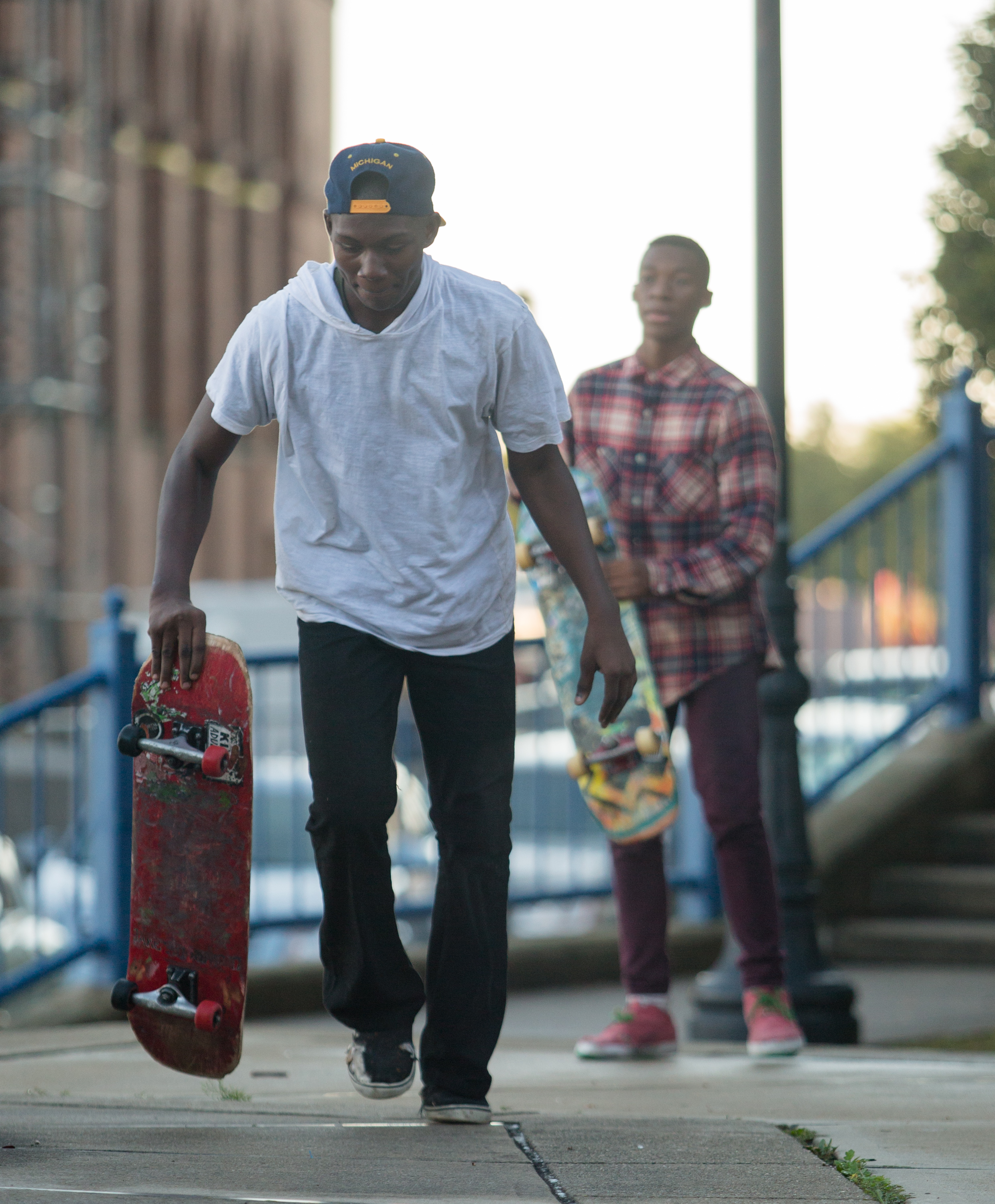 Gevante Wilson starts his run while his brother Gerald Lamar Wilson waits behind him on the steps behind the Imagination Station in downtown Toledo on Saturday, Sept. 17, 2016.