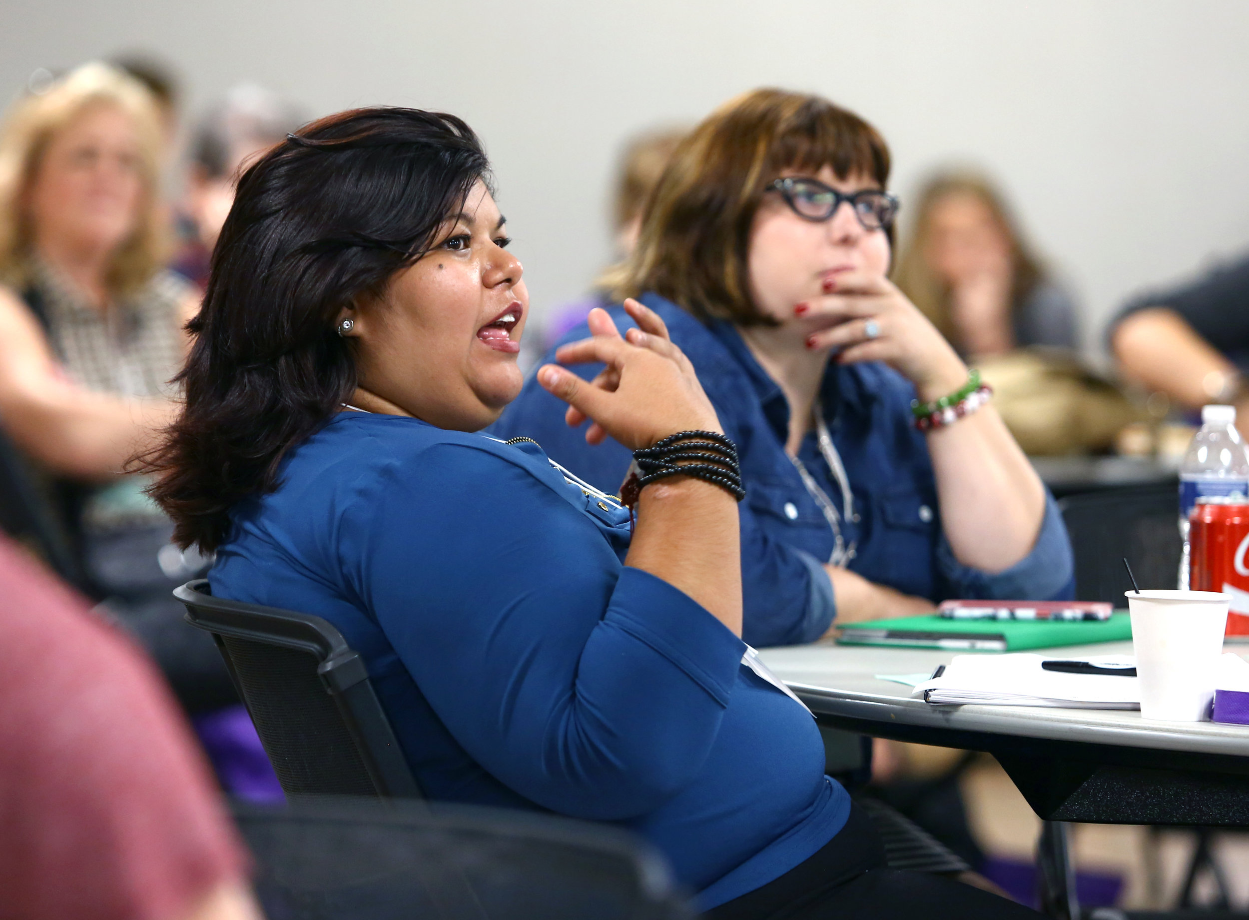 Marlett Garcia of El Paso Tx. interacts with speaker Theresa Flores during the University of Toledo Human Trafficking Social Justice conference held at the university's student union on Thursday, Sept. 22, 2016.