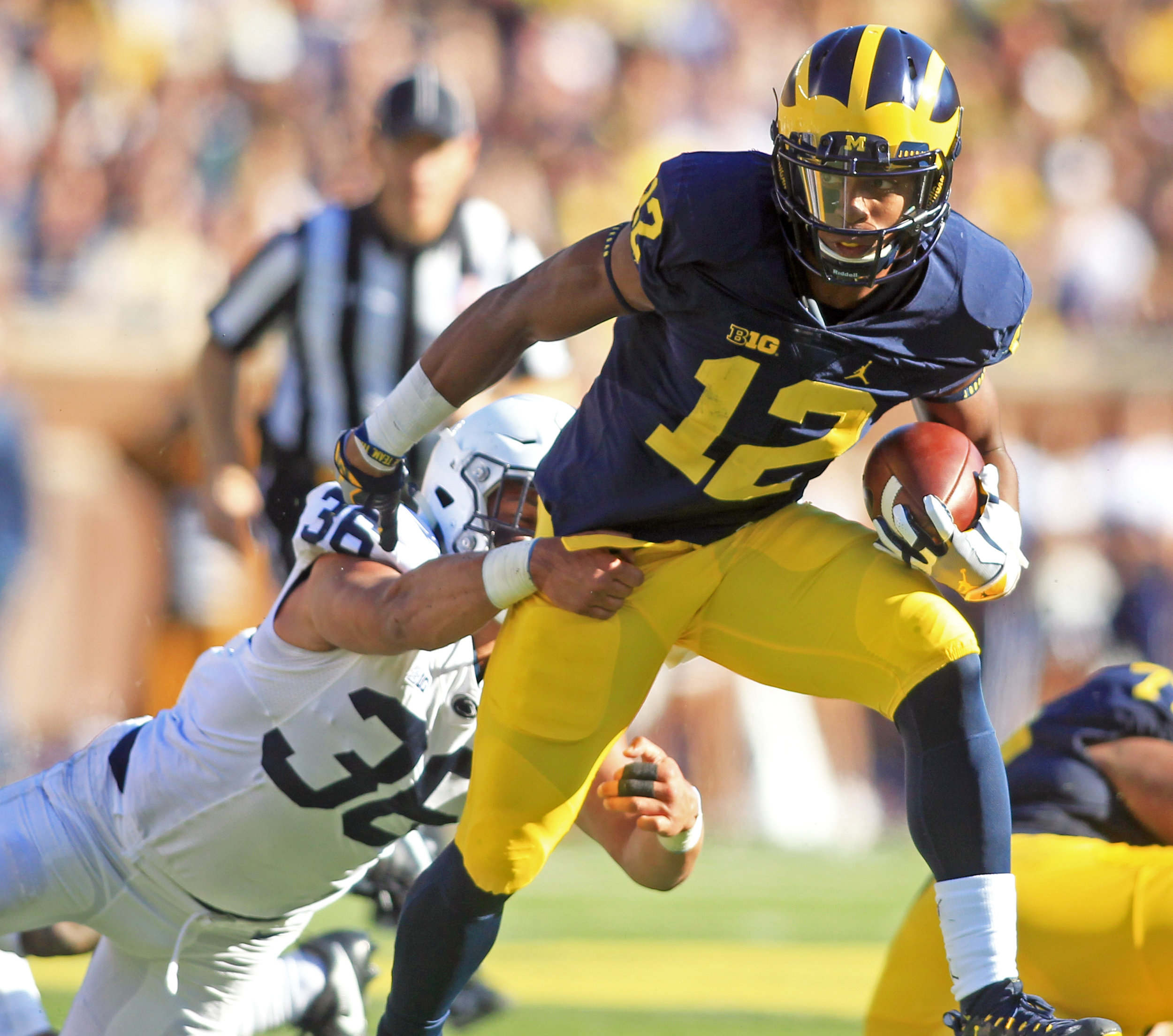 "Michigan running back Chris Evans breaks a tackle from Penn State linebacker Jan Johnson during the game at ""The Big House"" in Ann Arbor on Saturday, Sept. 24, 2016. Michigan won the game 49-10."