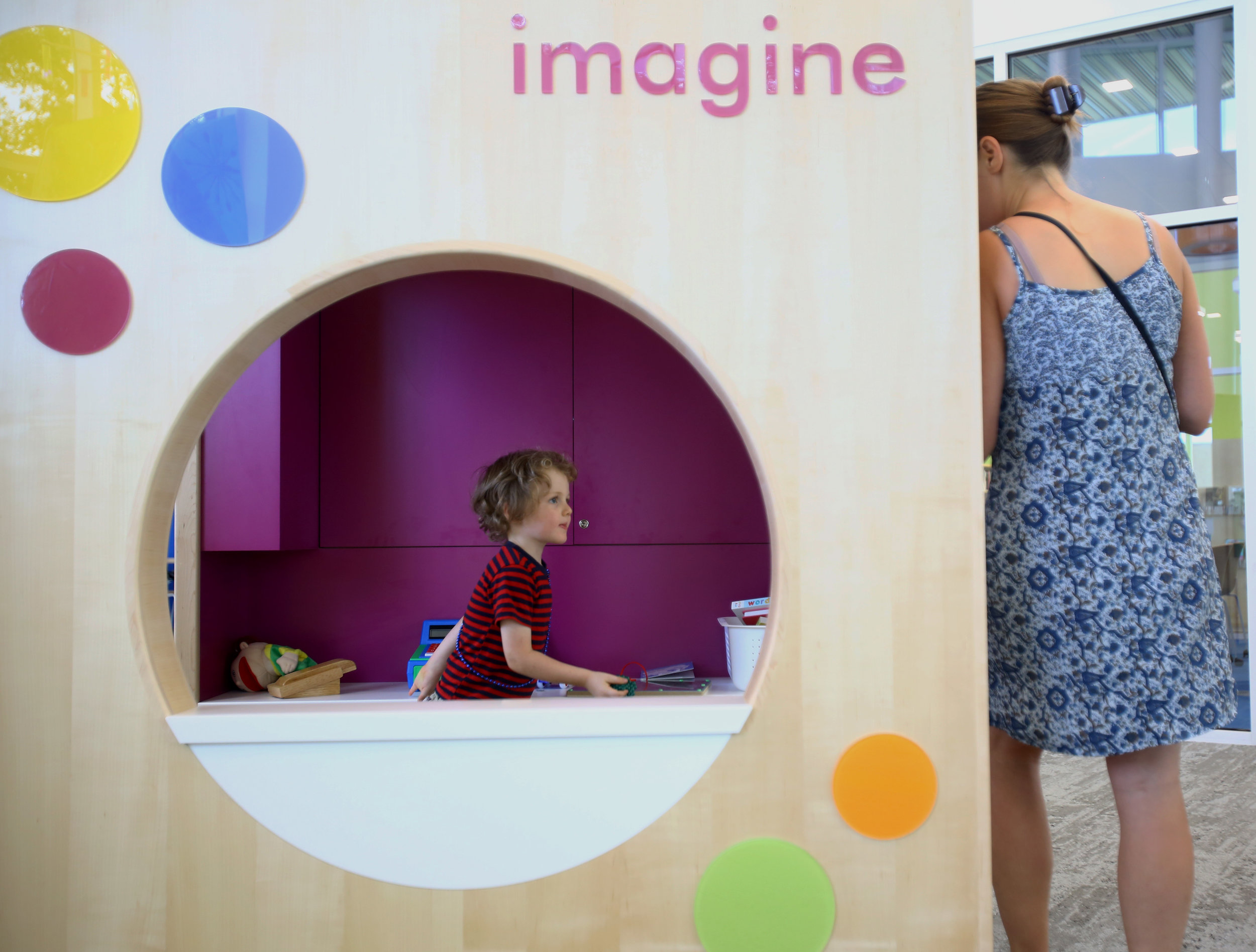 Amos Woods, 4, of Sylvania plays in the children's section of the newly opened King Road branch of the Toledo Lucas County Public Library in Sylvania with his mother Brenda Woods on Monday, Sept. 26, 2016. Brenda Woods saw on Facebook that the library had opened and said that the new branch would be their regular library after always having to go to the Holland branch.