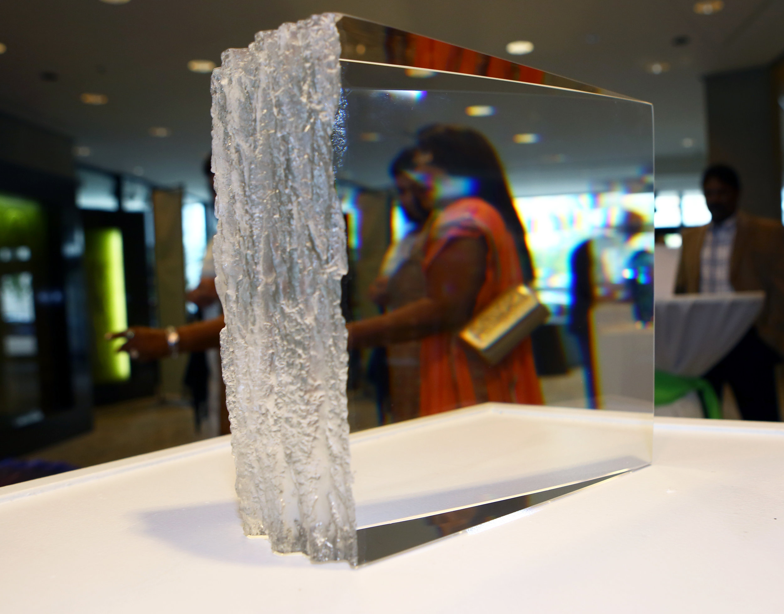 """Attendees walk past the """"White Pine"""" prism piece by Joel O'Dorsio during the Hot Shots! fundraiser benefitting The Arts Commission at the Edison Building in downtown Toledo on Saturday, October 1, 2016."""