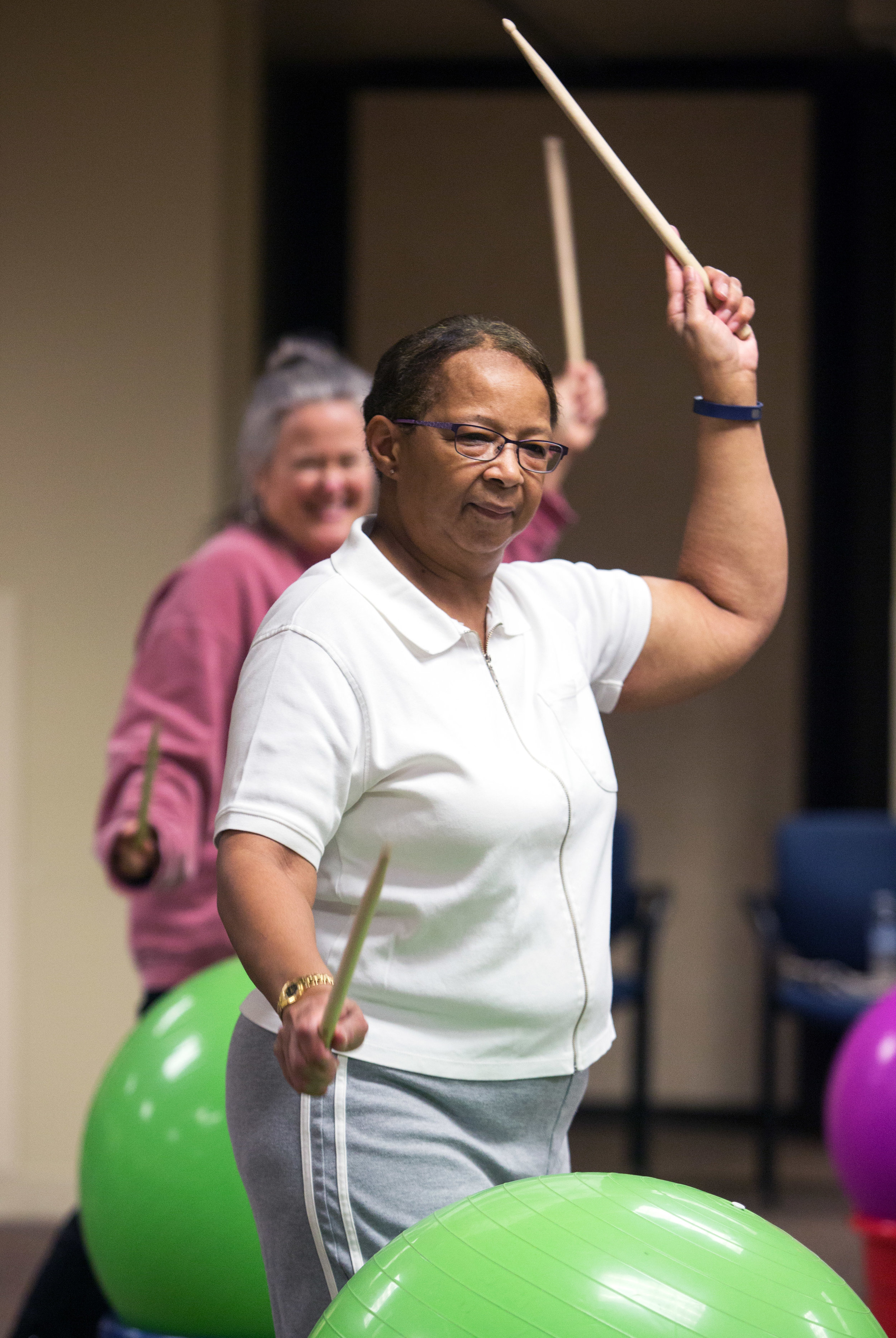 Sheila Googins of Toledo, front, and Marnie Arndt, back, follow along with a choreographed routine during the weekly cardio drumming for cancer survivors work out in the Heath and Human Services Building at University of Toledo on Thursday, Oct. 20, 2016.