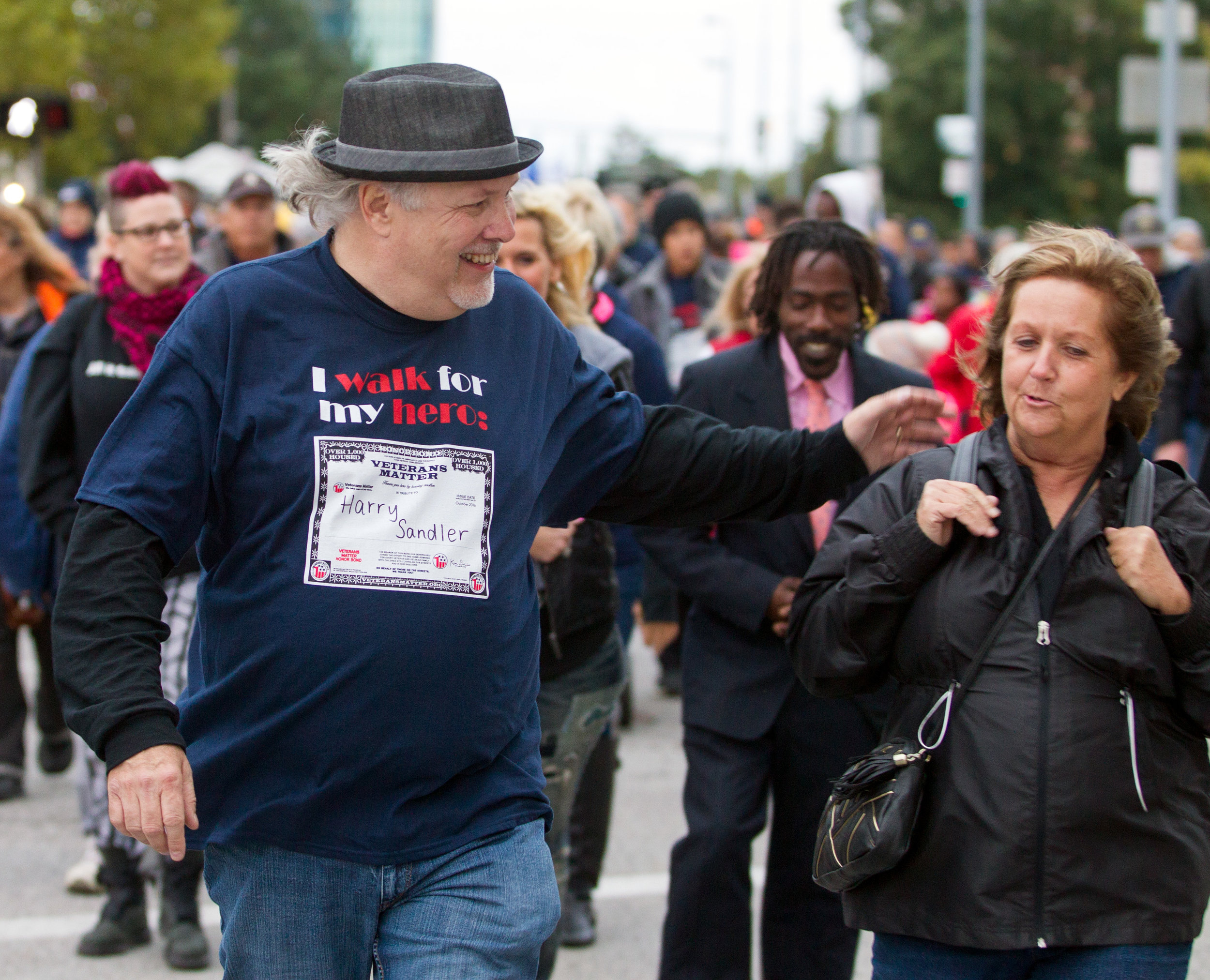 Veterans Matter advocate in chief Ken Leslie speaks with other participants as he leads the Walk to End Veteran Homelessness down Jackson St. in Downtown Toledo on Friday, Oct. 21, 2016.