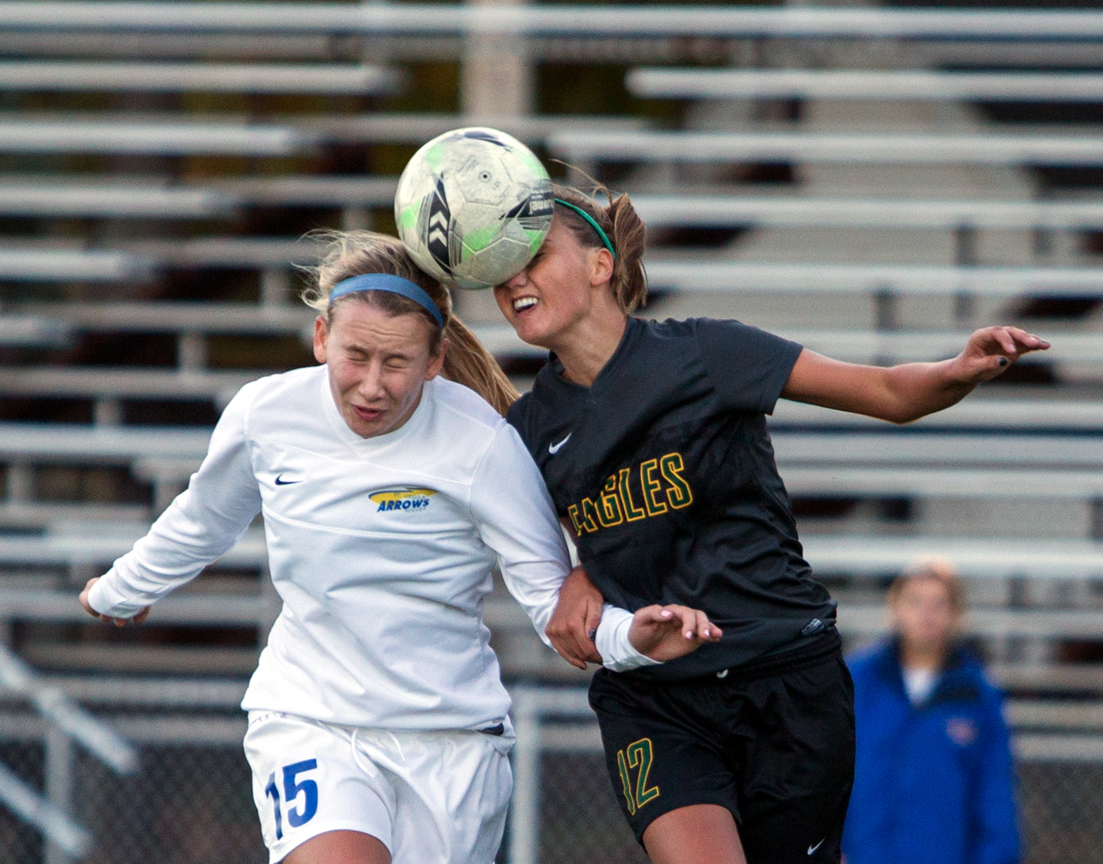 St. Ursula's Grace Turski (15) jumps for a header against Clay High School's Hannah Gerrard during the Division I girls soccer district tournament at Northview High School Monday, Oct. 24, 2016.