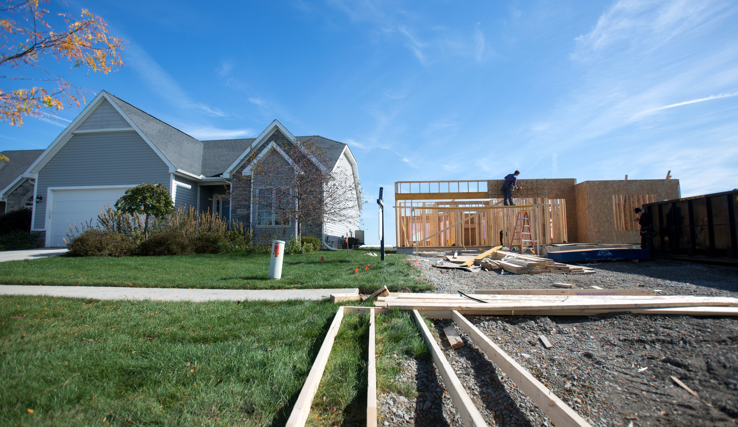 Brett Wickey of Spencerville works on the front of a house under construction in the Rivers Edge sub division on Hidden Ridge drive in Perrysburg on Tuesday, Oct. 25, 2016.