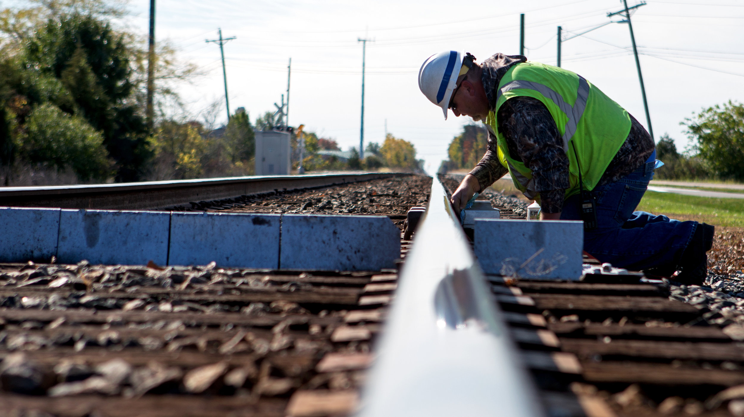 CSX signal maintainer Matt McDonald of Willard, Oh. tests the defect detection device on a section of railroad off of Fort Meigis Rd. near the Little Township Baseball Field in Perrysburg on Tuesday, Oct. 25, 2016. The defect detection system reads temperatures and detects anything dragging from train cars as they pass and notifies the headquarters and dispatch of any malfunctions.