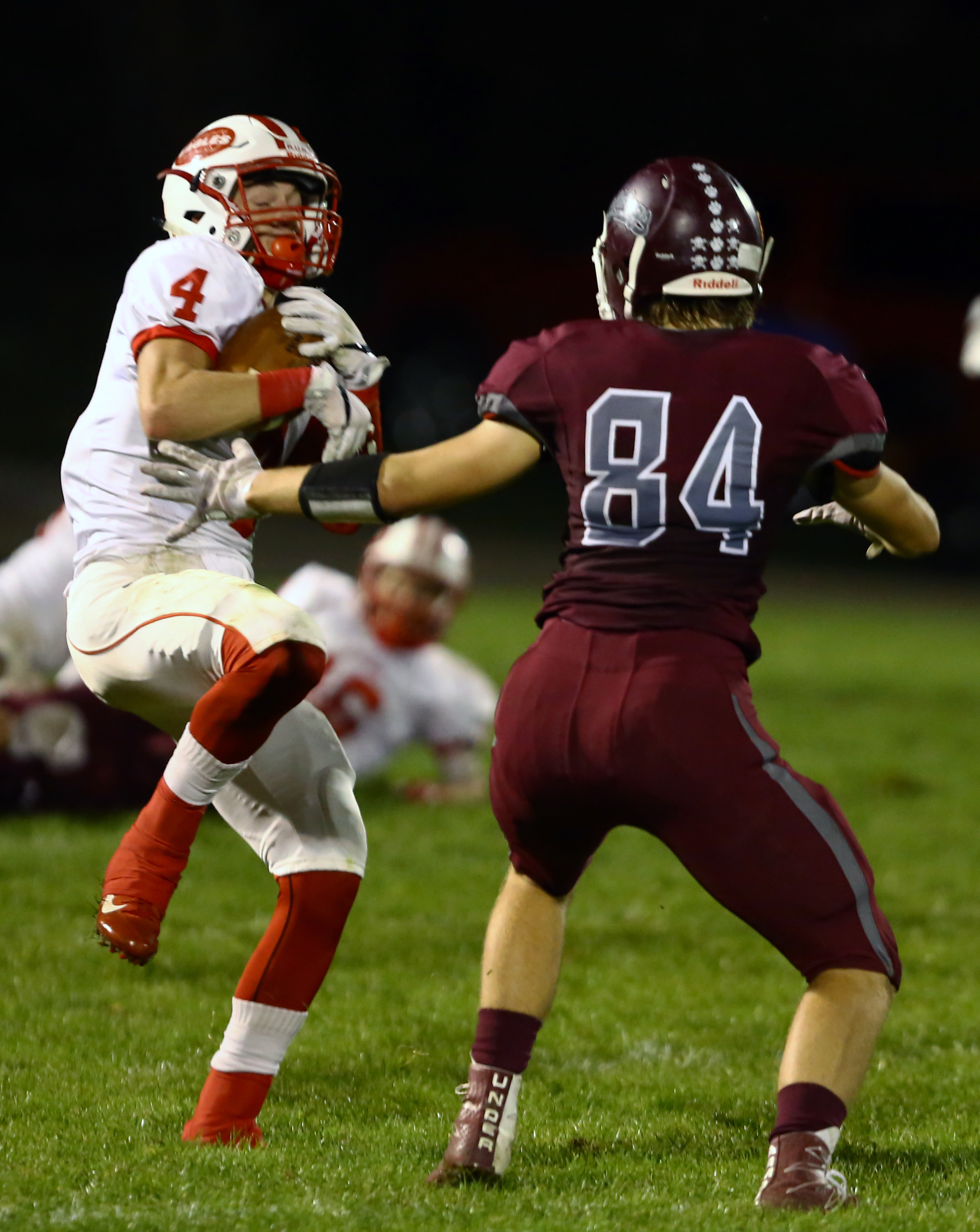 Eastwood High School defensive back Cade Boos intercepts a pass intended for Rossford High School Adam Sauter in the first half of the football game at Rossford High School on Friday, Oct. 28, 2016. Eastwood leads at the half 42-21.
