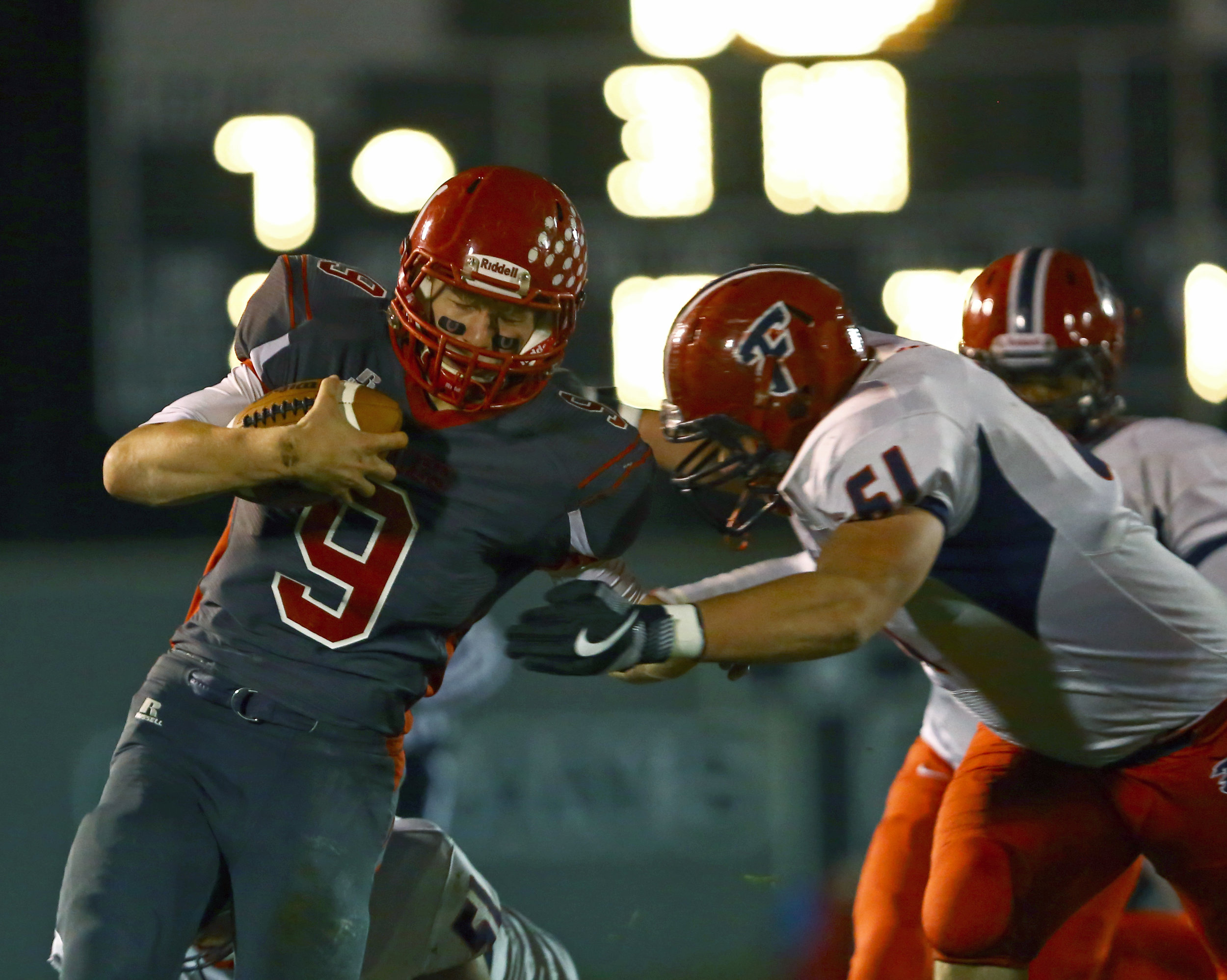 Bedford High School quarterback Joey Wiemer (9) braces for a tackle from Franklin High School defensive lineman Devin Visnaw (61) during the football game at Bedford High School in Temperance, Mi. on Friday, Nov. 4, 2016.