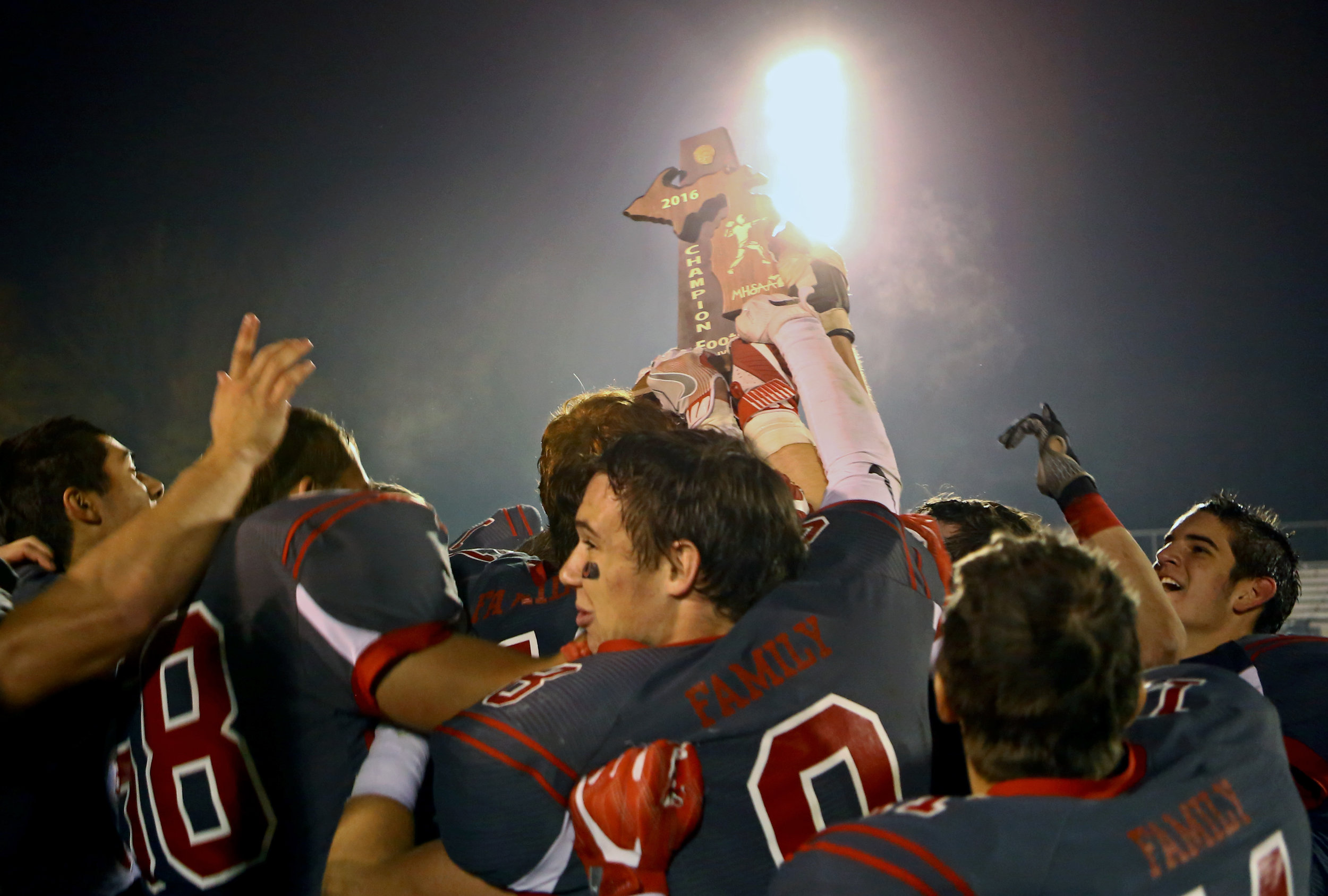 Members of the Bedford High School football team celebrate after receiving the MSHAA Div. 2 Champions trophy after their 39-22 victory over Franklin High School at Bedford High School in Temperance, Mi. on Friday, Nov. 4, 2016.