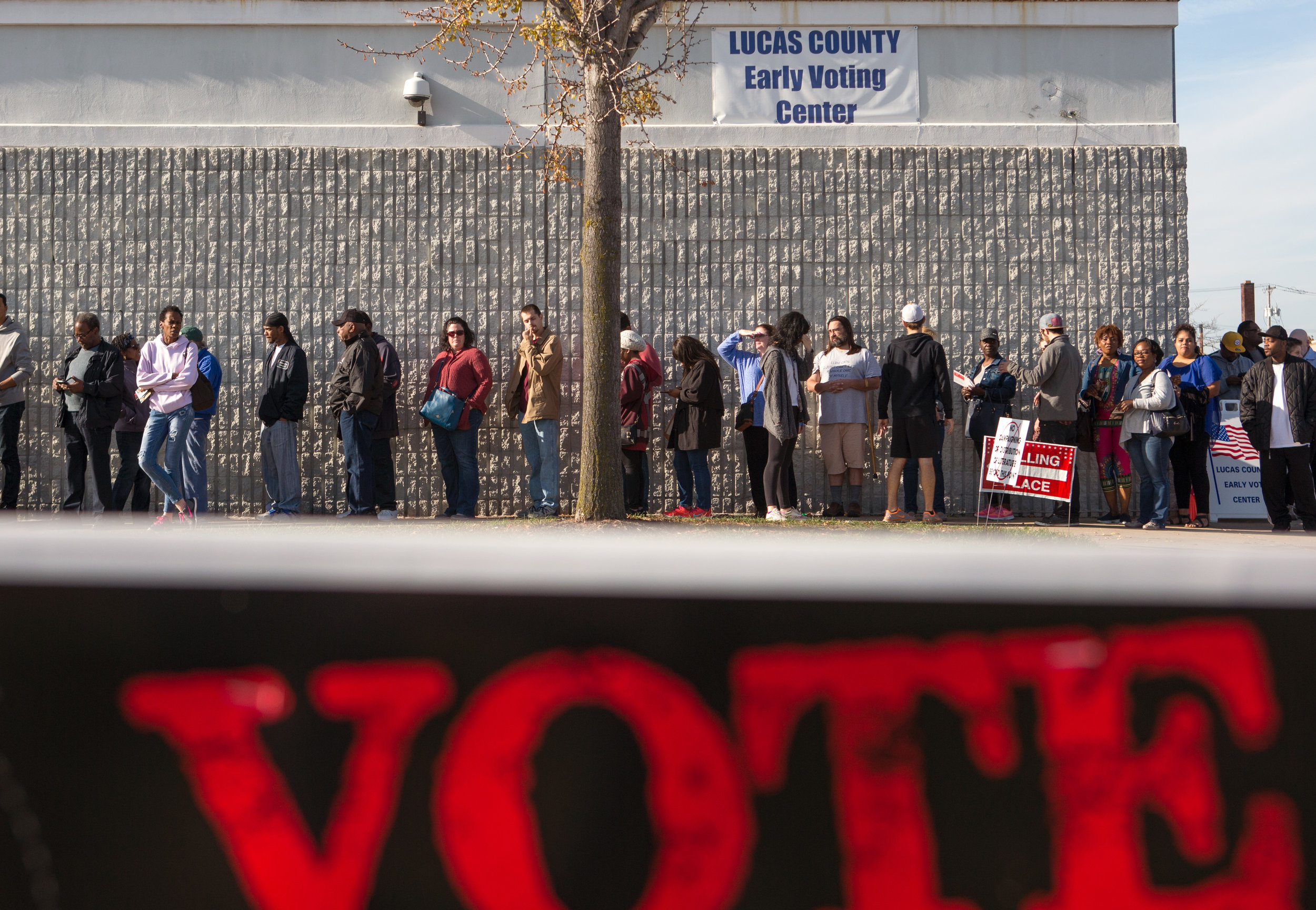 Early voters wait in a line that wraps around the outside of the Lucas County Early Voting Center on Monroe St. in Toledo to cast their vote in the upcoming election on Saturday, Nov. 5, 2016.